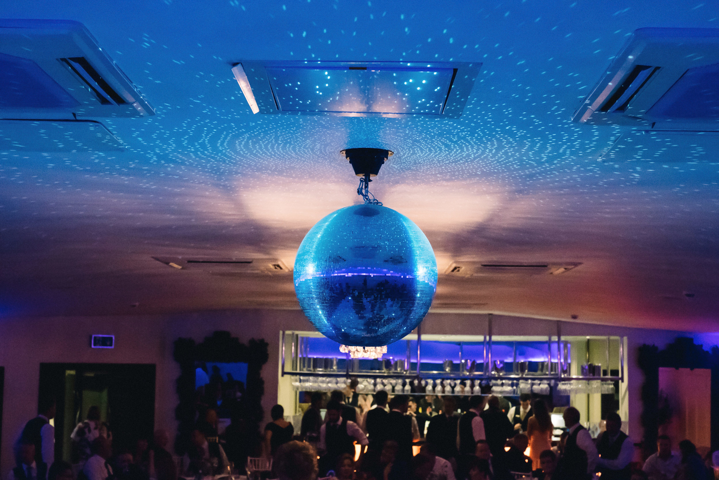 Disco ball and dancing guests