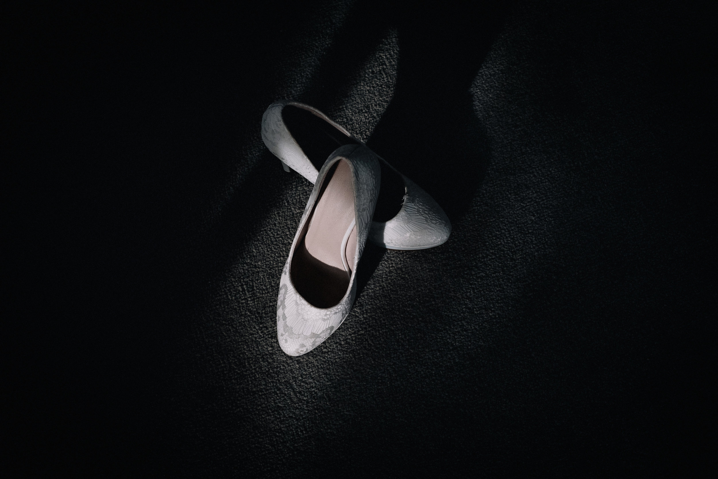 Bridal shoes in a shadows