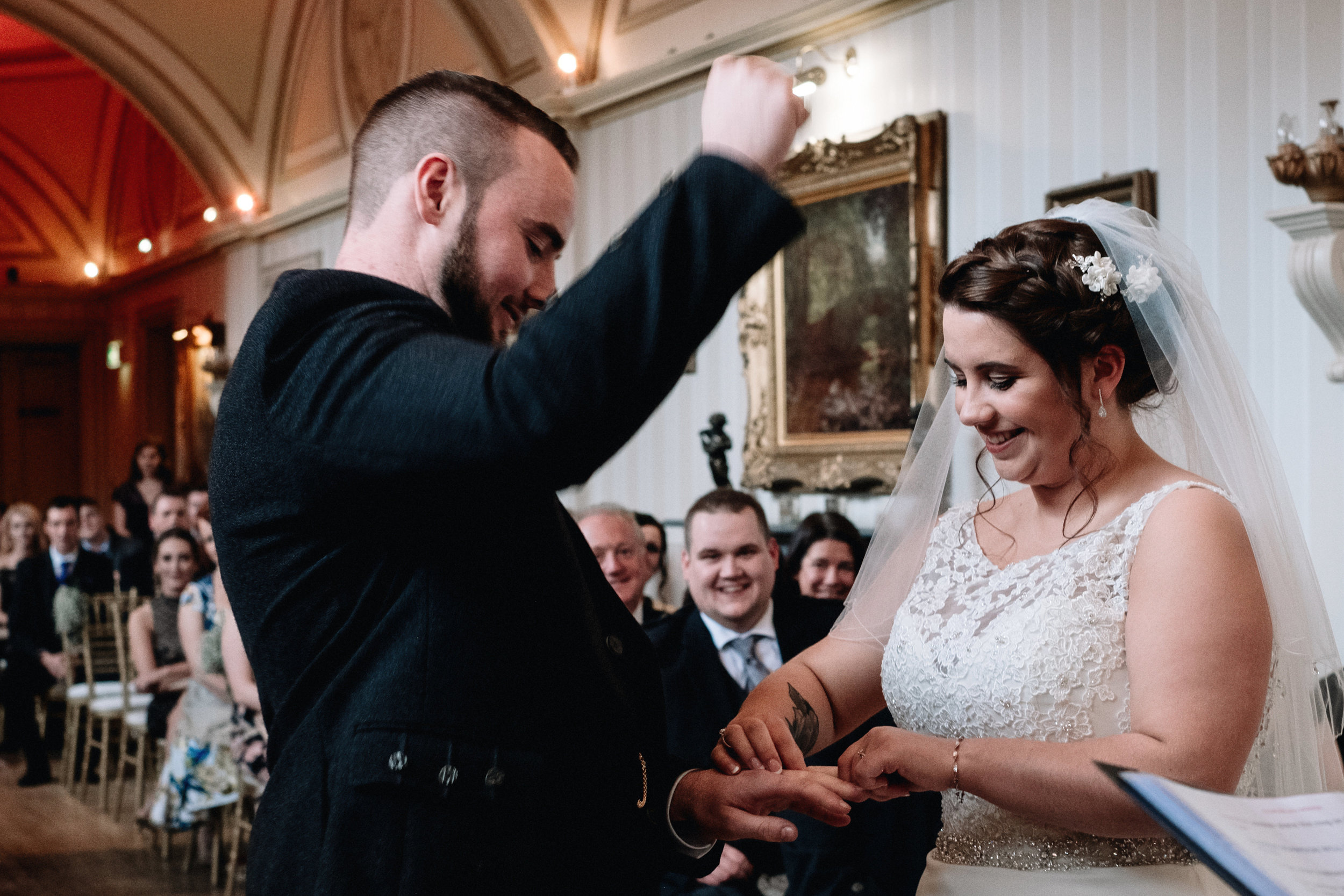 Groom fist punches the air
