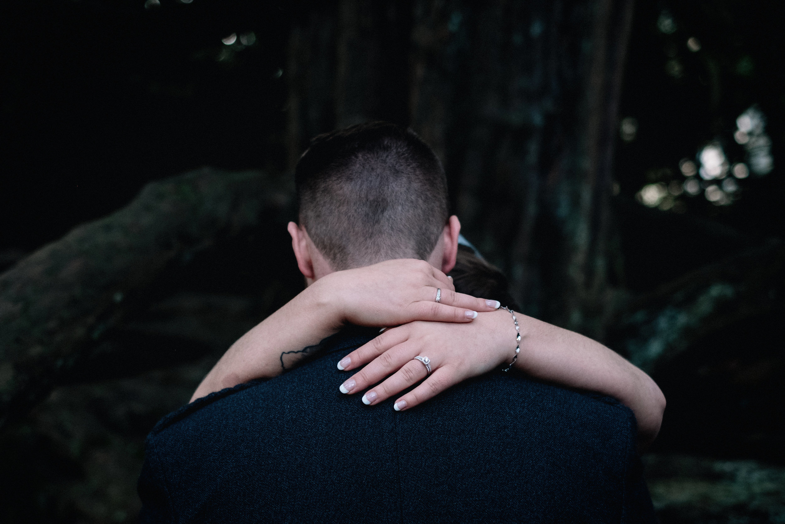 Bride and groom embrace in a Scottish forrest