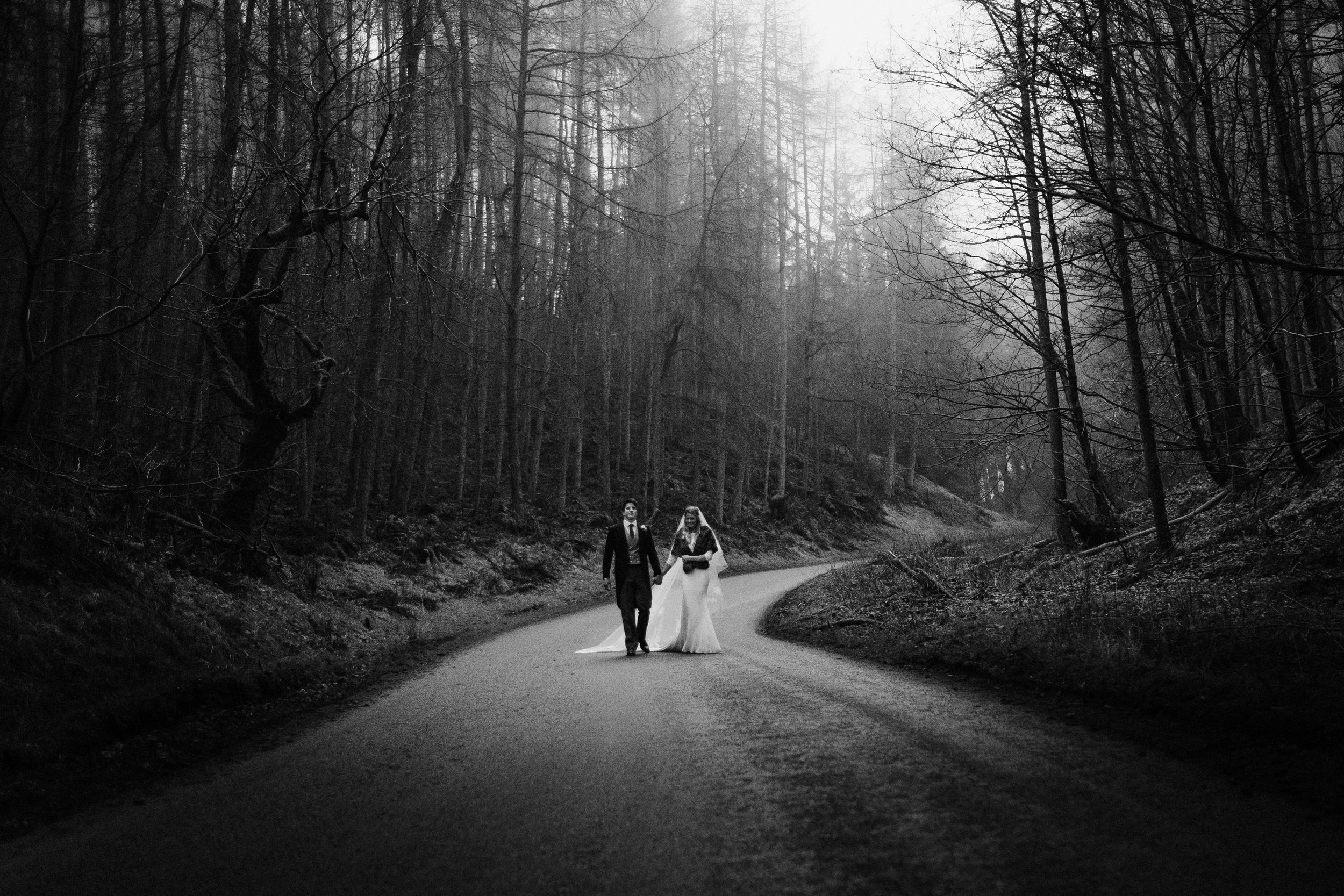 Grand forest scene of bride and groom walking