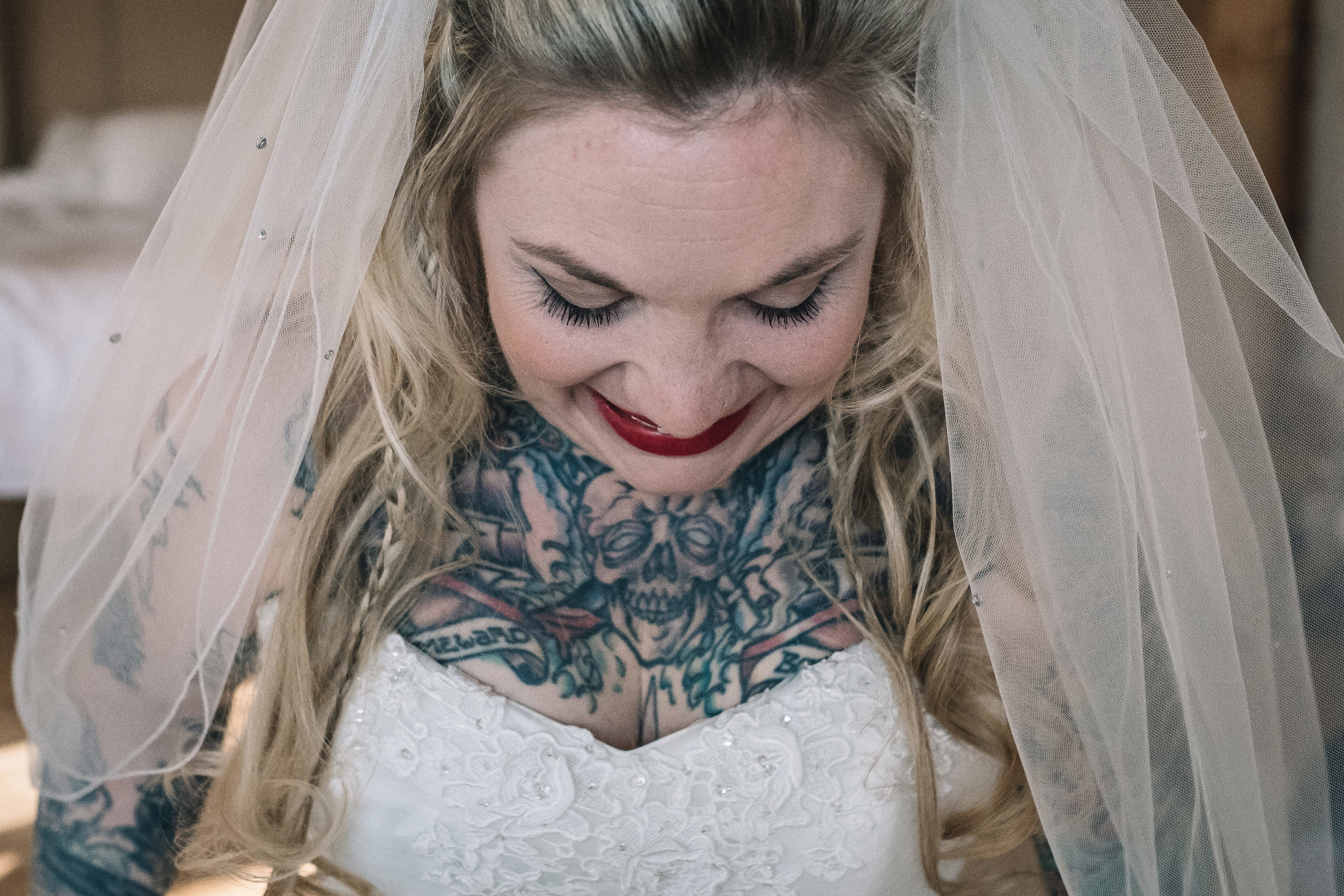 Tattooed bride smiles