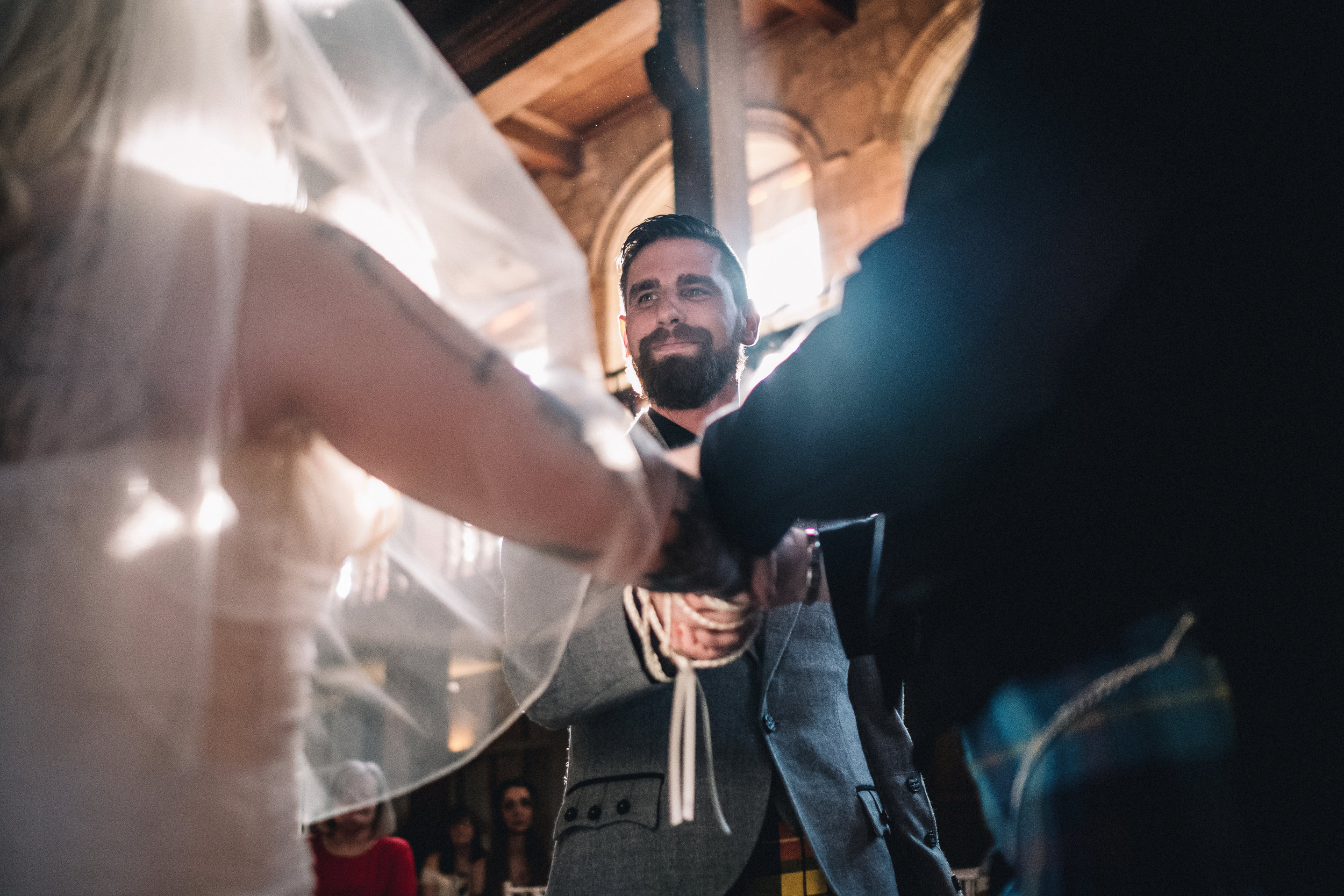 Hand fasting during wedding ceremony
