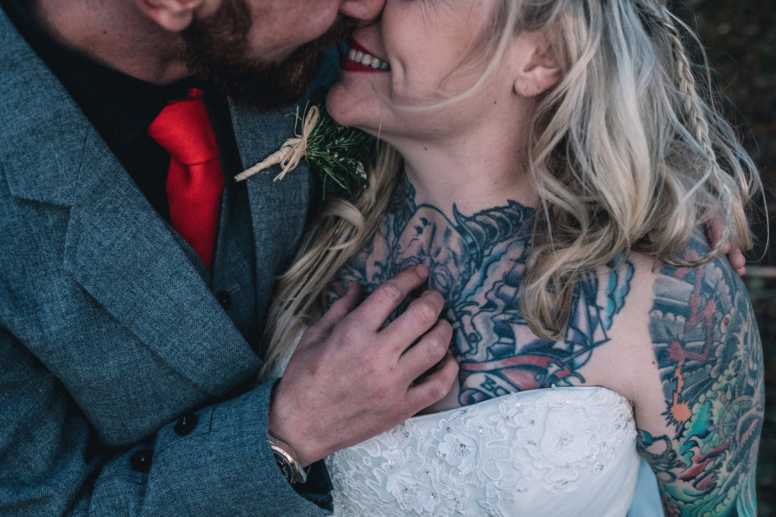 Close embrace of bride and groom
