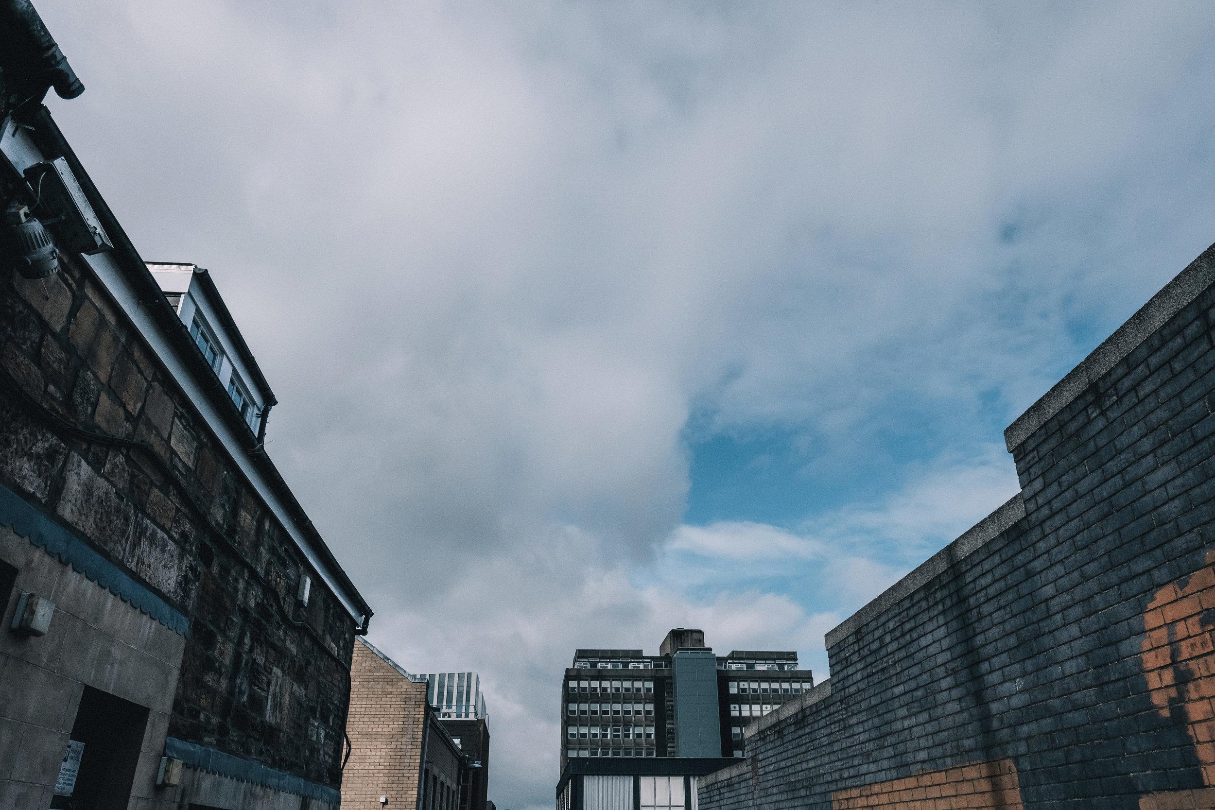 Blue sky amidst buildings
