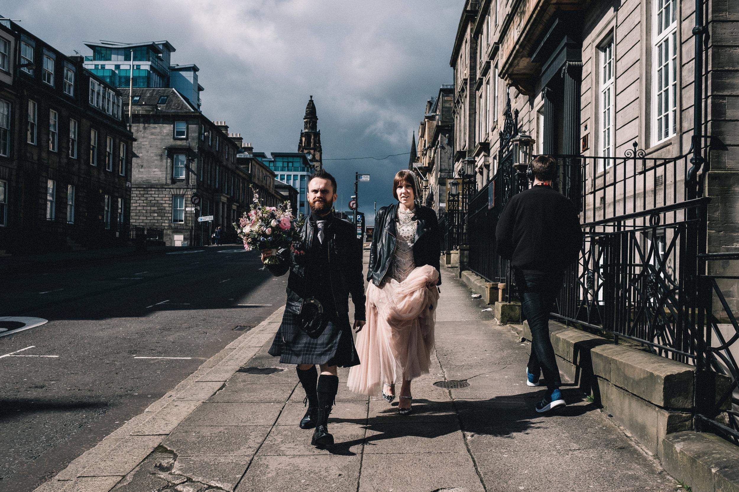 Bride and groom walking in Glasgow