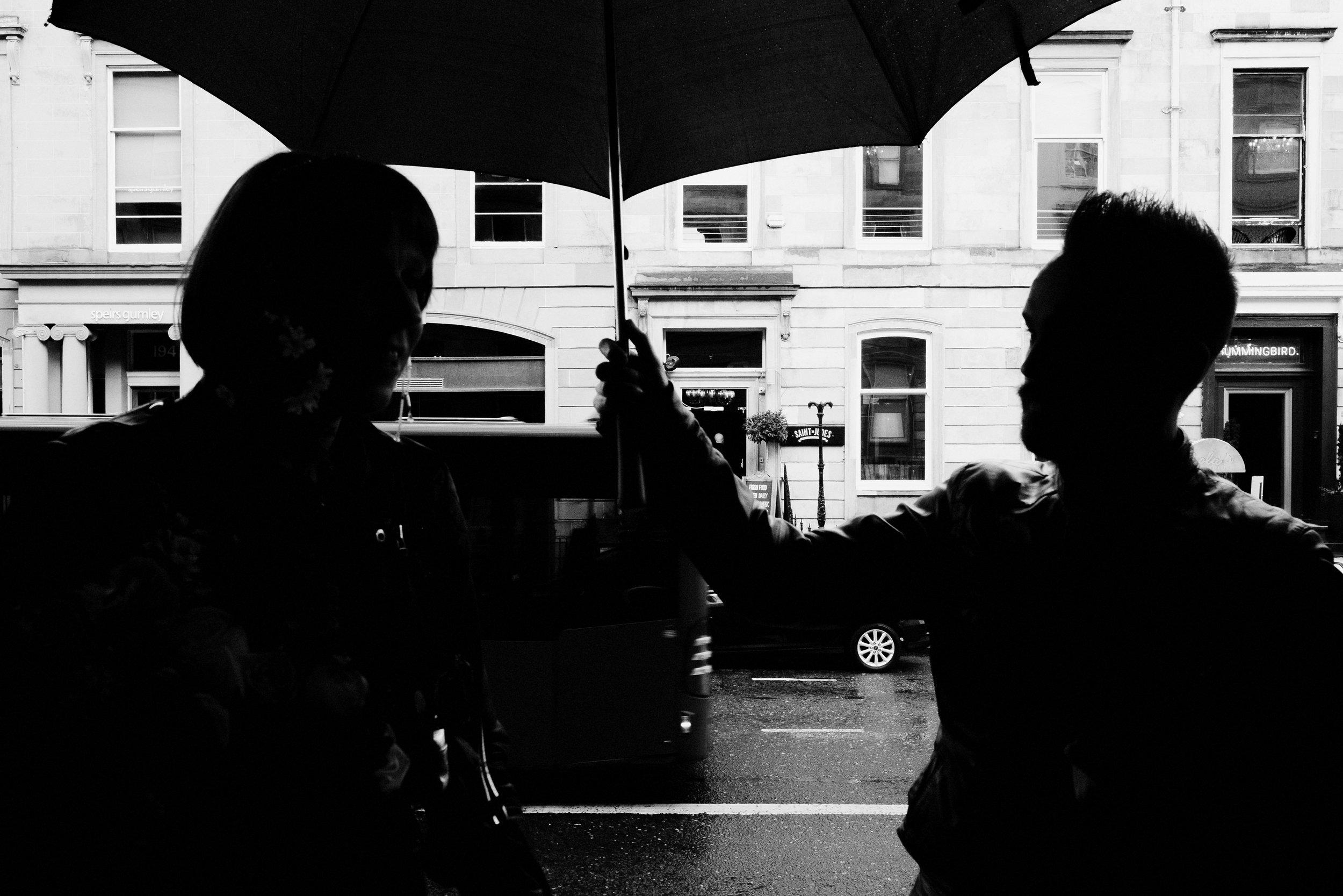 Silhouette of couple under umbrella