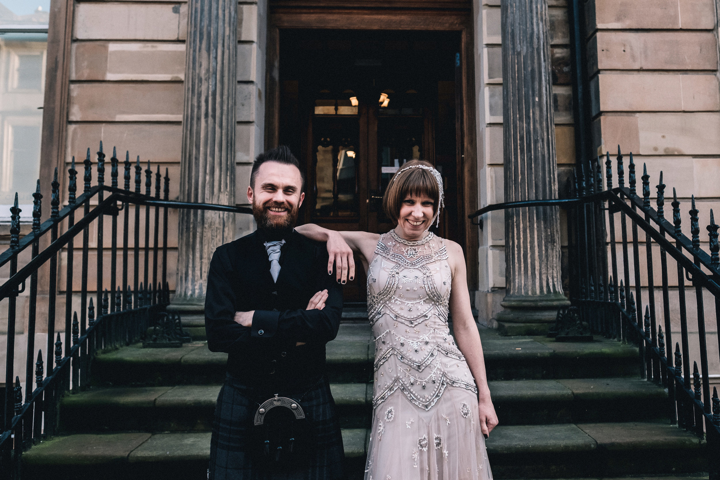 Smiling married couple look straight to camera