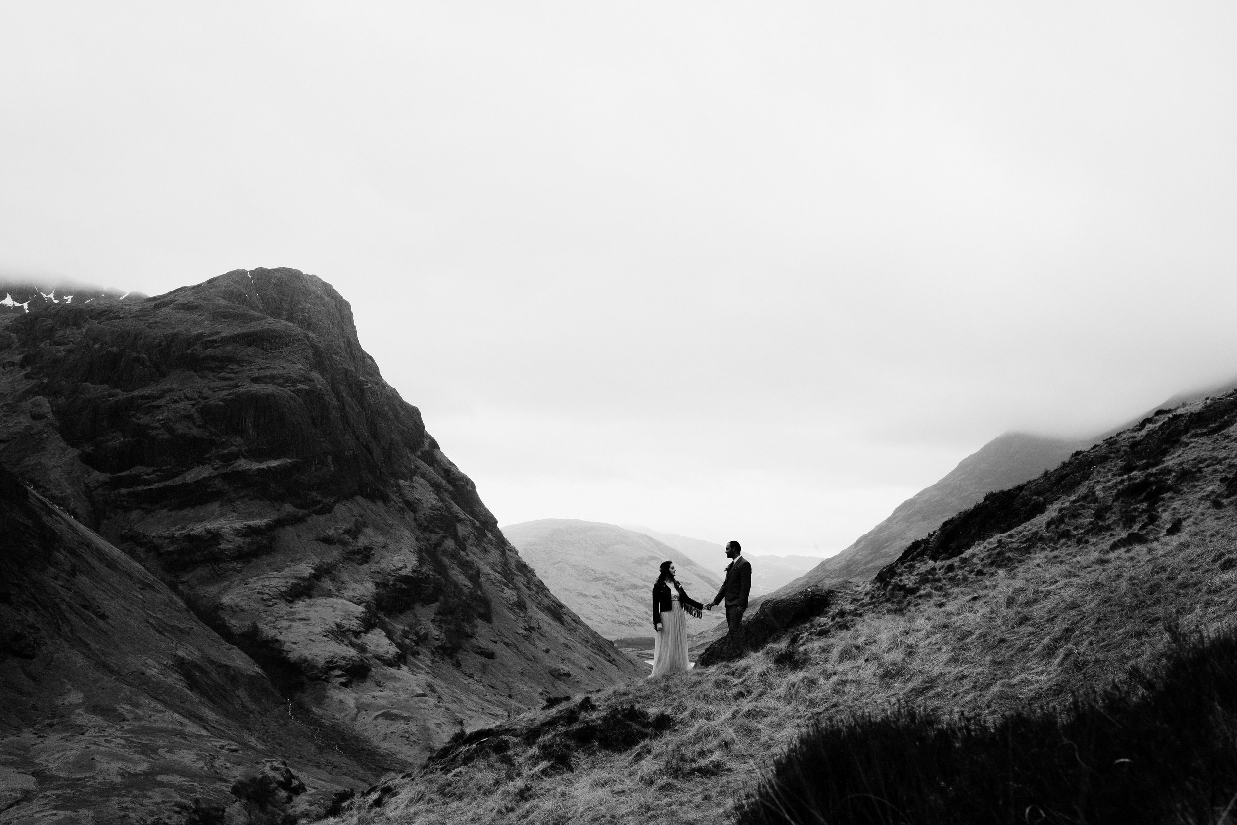 Bride + groom silhouetted against mountains