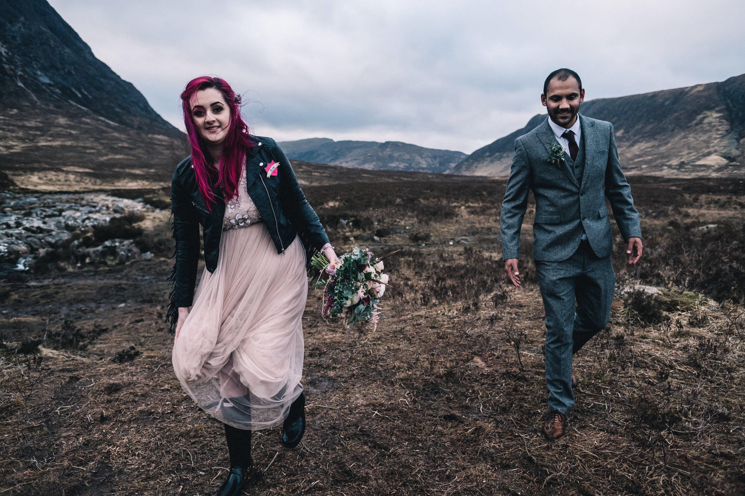 Eloped couple walk at the foot of Buchaille Etive Mor