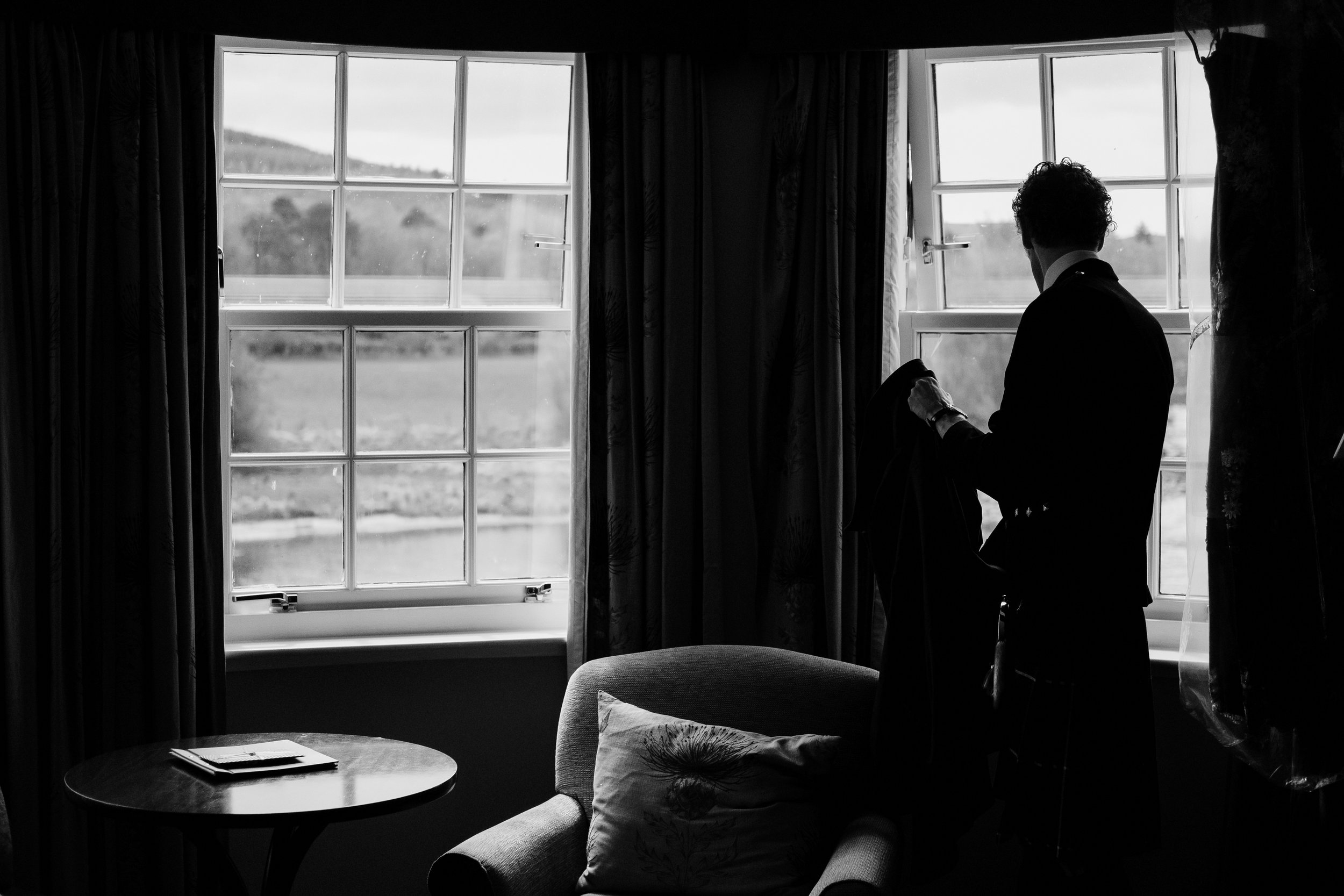 Groom looks out of window