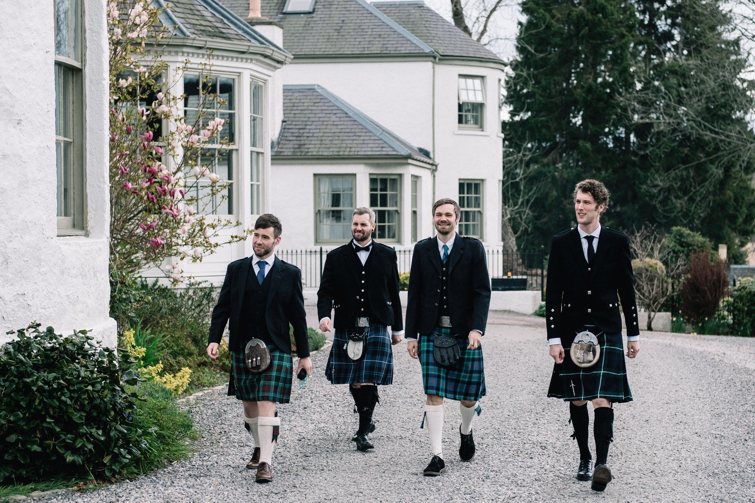 walking groomsmen