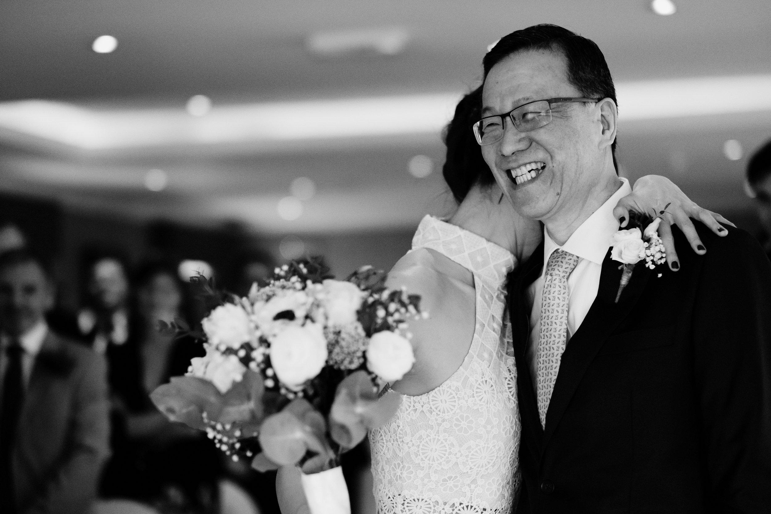 Bride hugs father following walking down the aisle