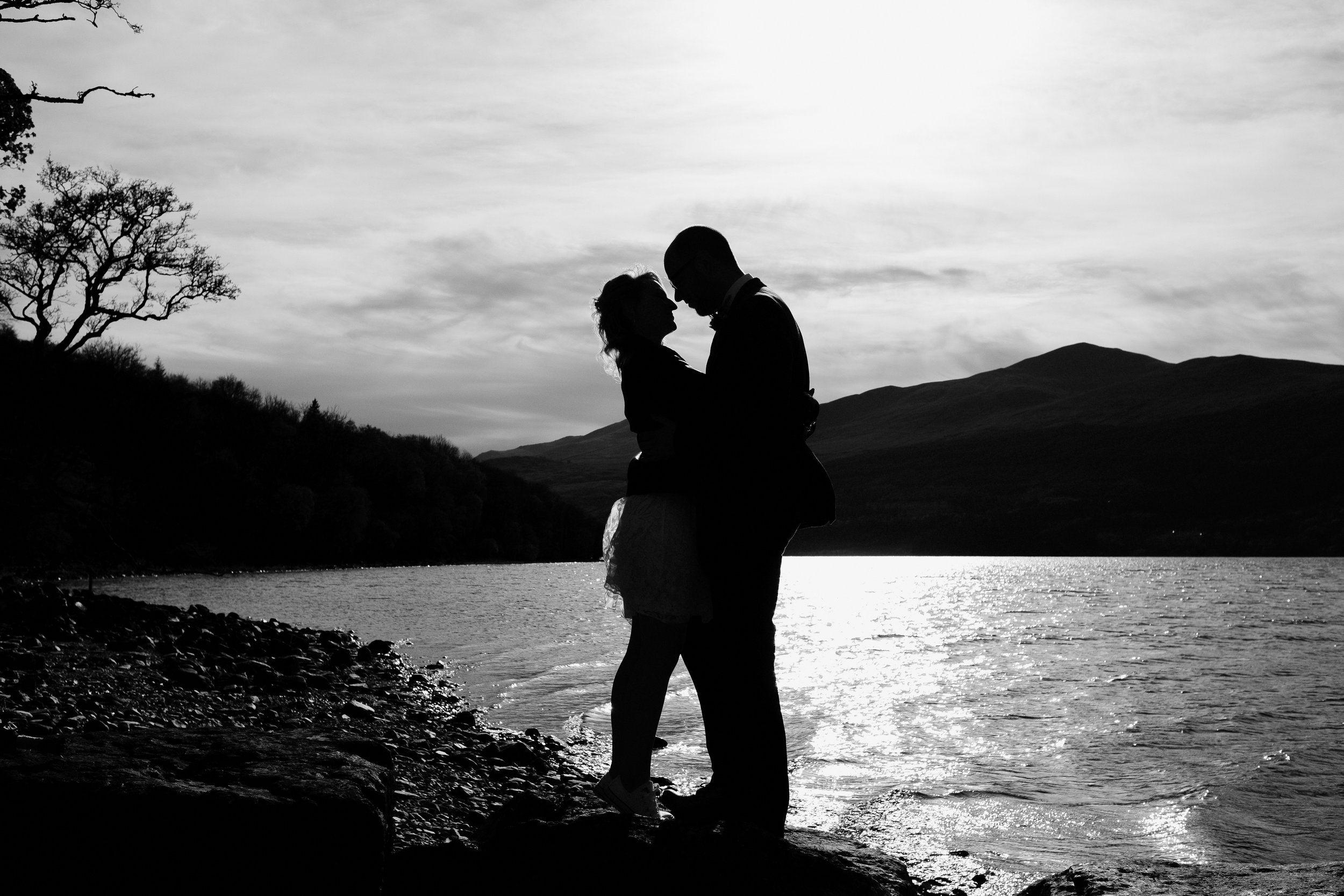 Couple embrace by Loch Tay