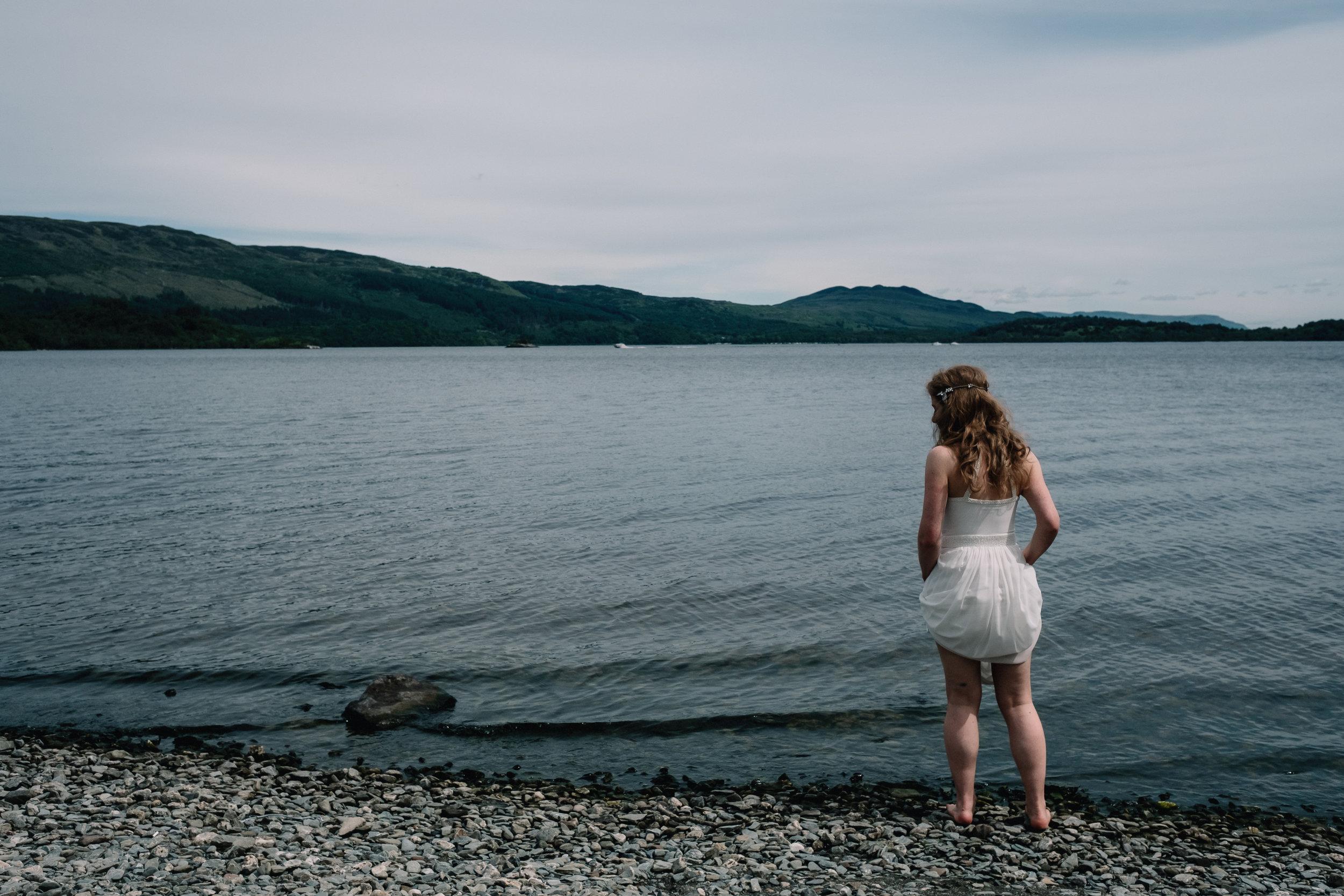 Bride stands by Loch Lomond