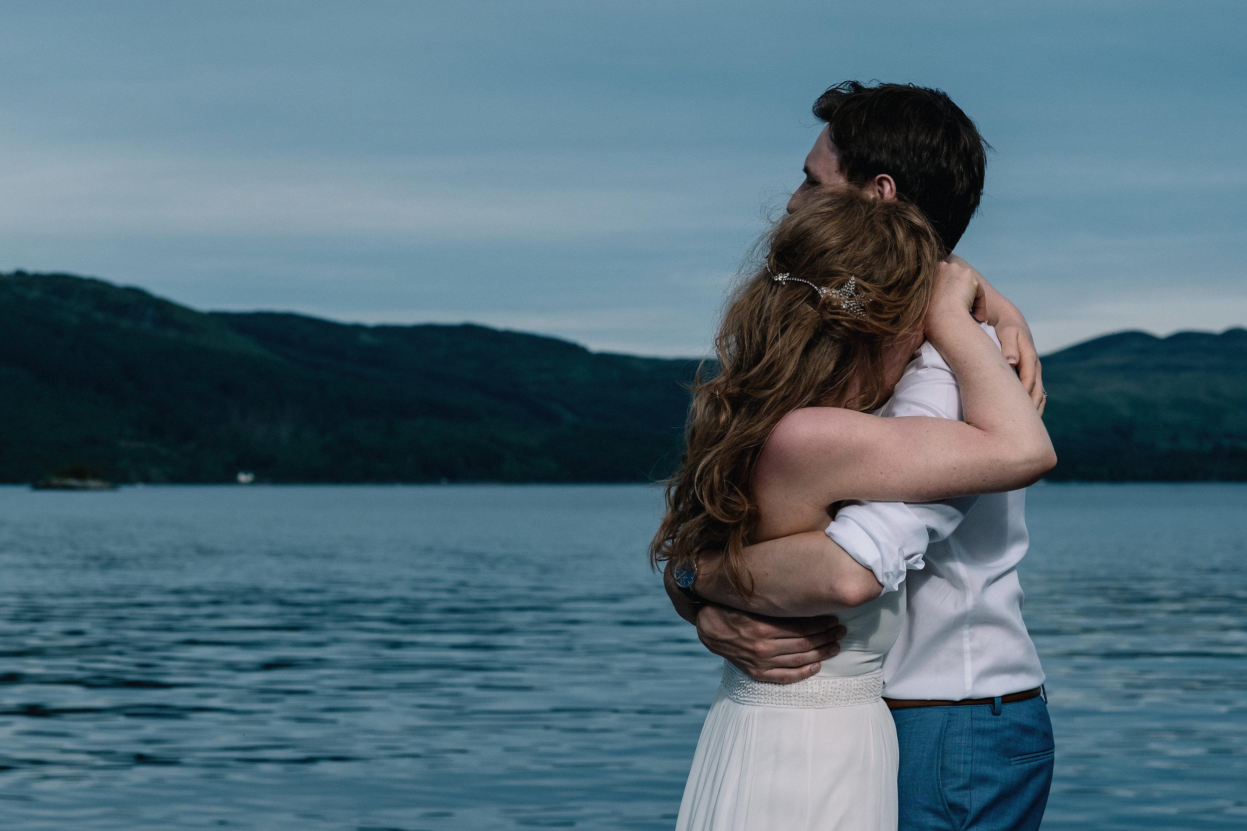 Hugging bride and groom