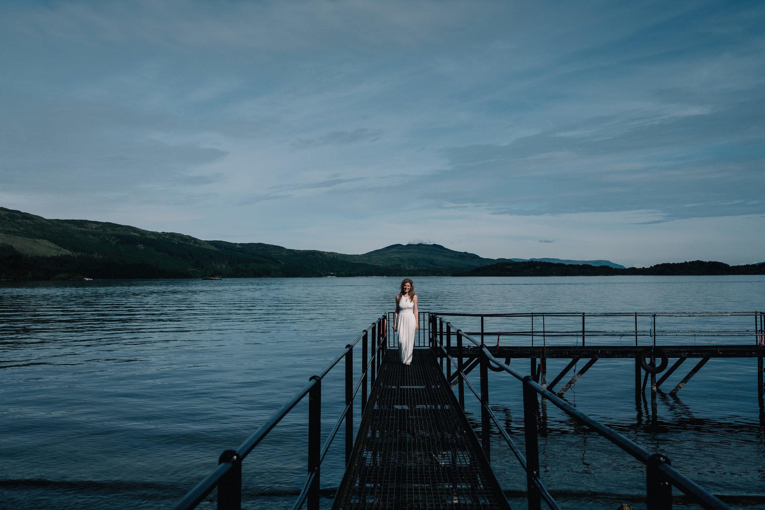 Bride stands on pier