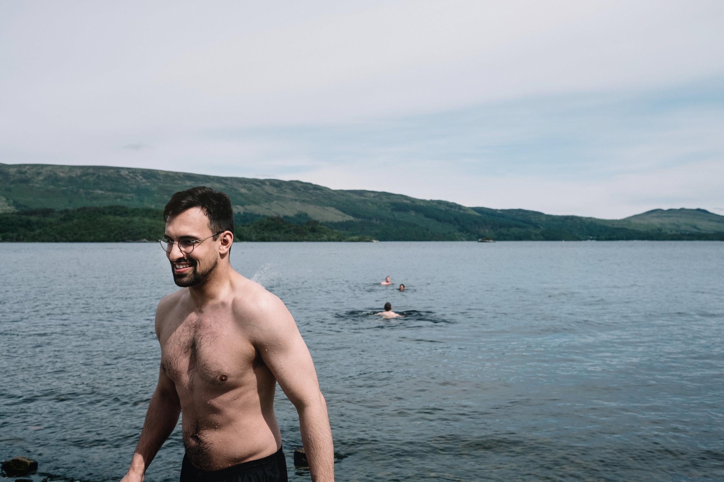 Wedding guest swimming in Loch Lomond