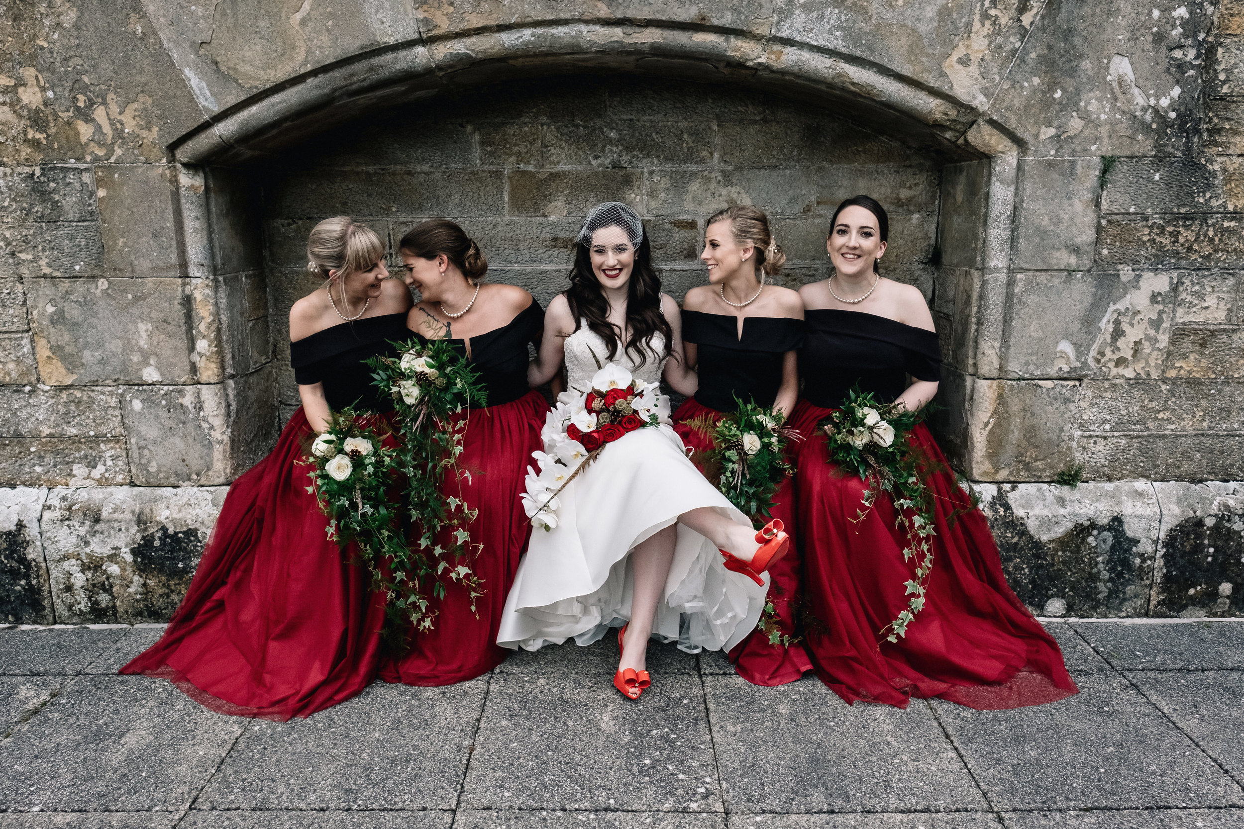Bride sits with bridesmaids