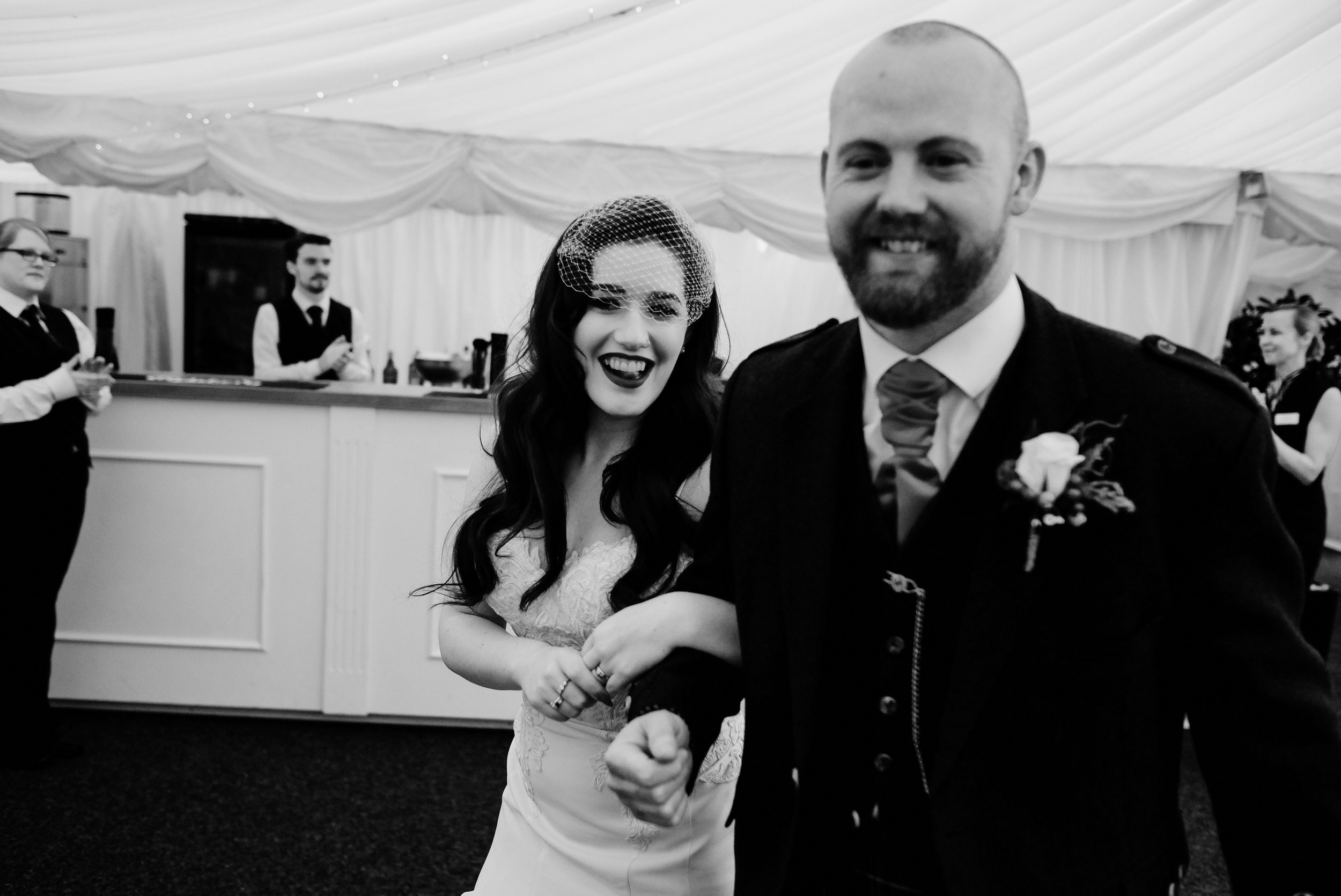 Bride and groom piped into wedding breakfast