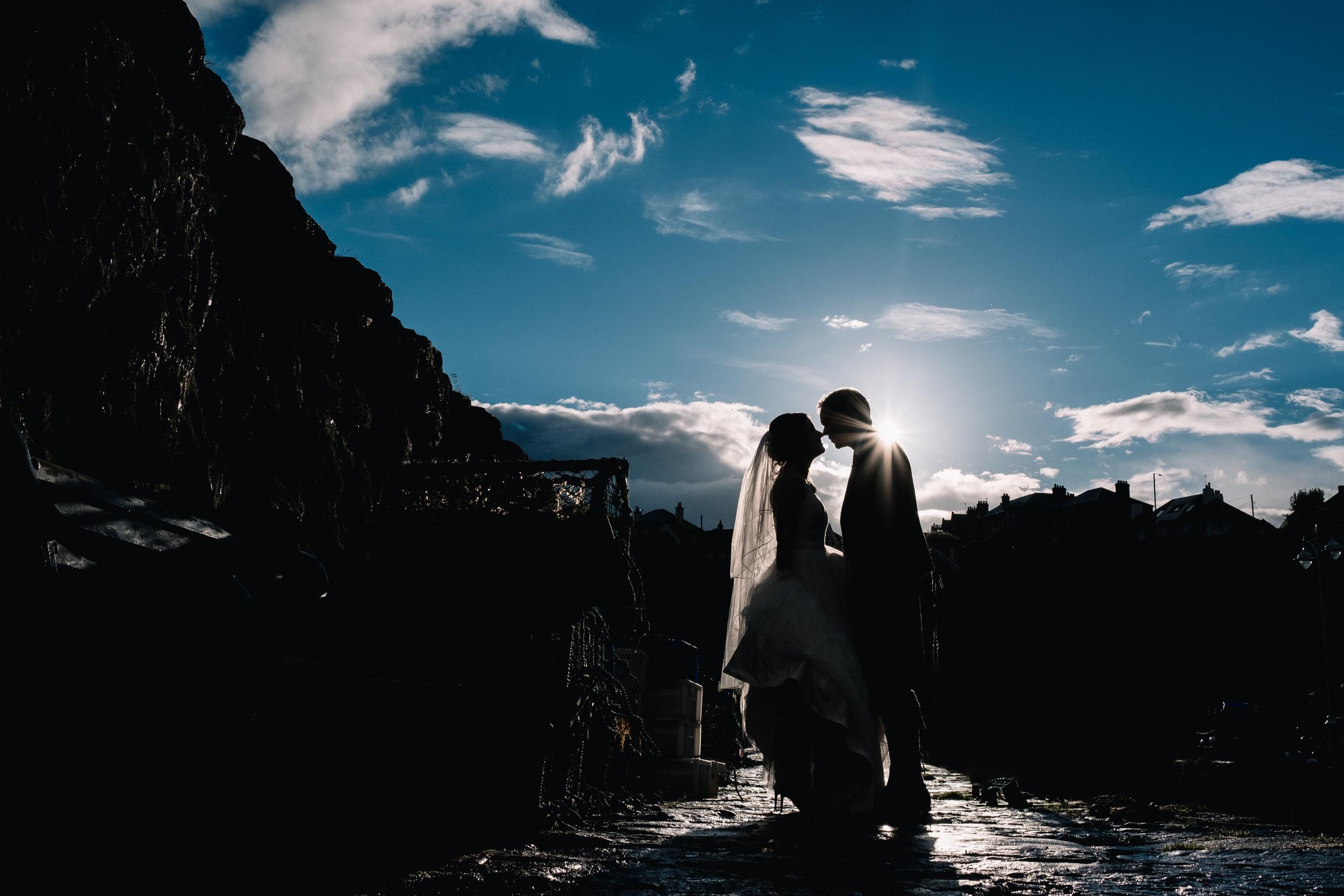 Bride + groom in sunlight