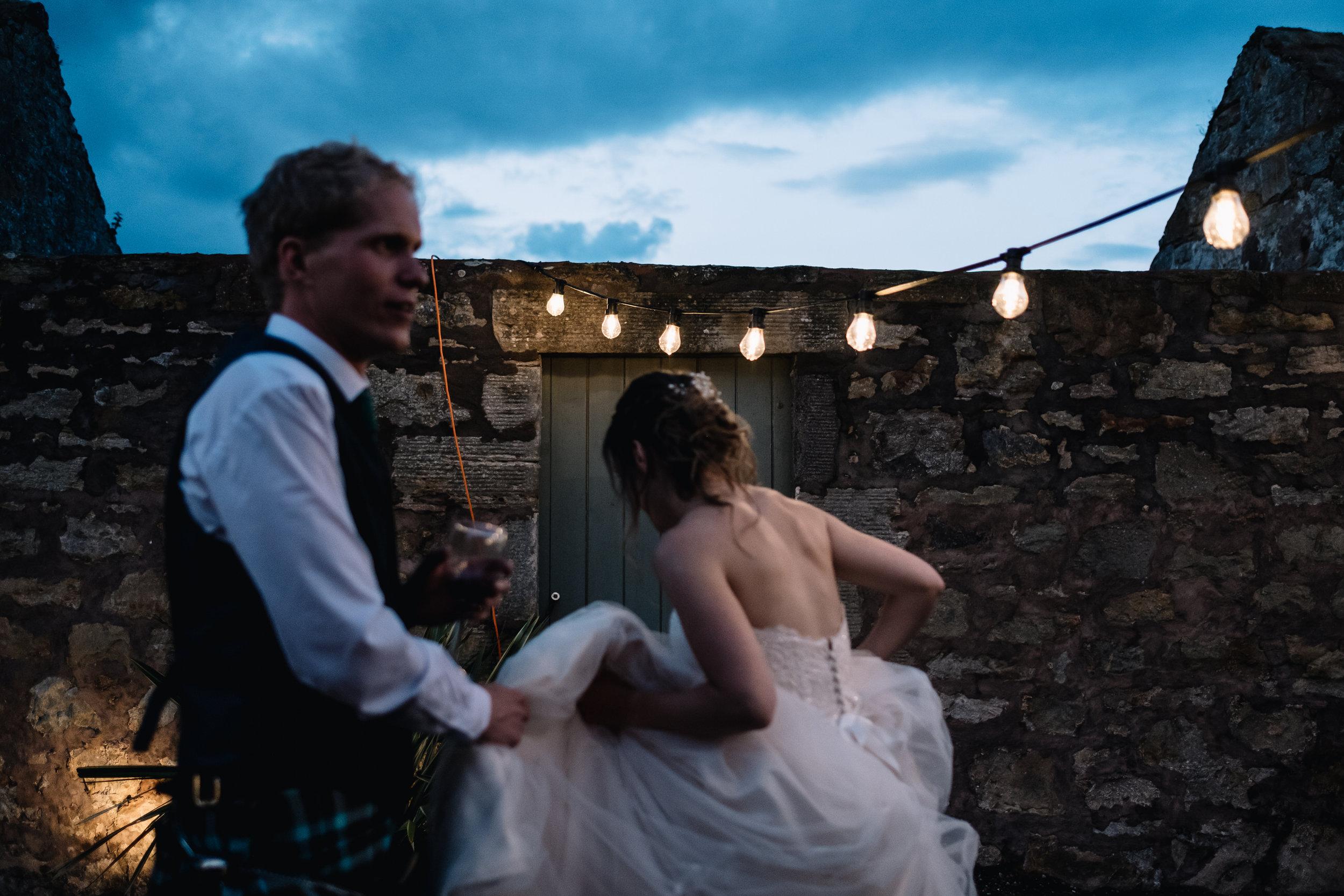 Bride + groom outside after sunset