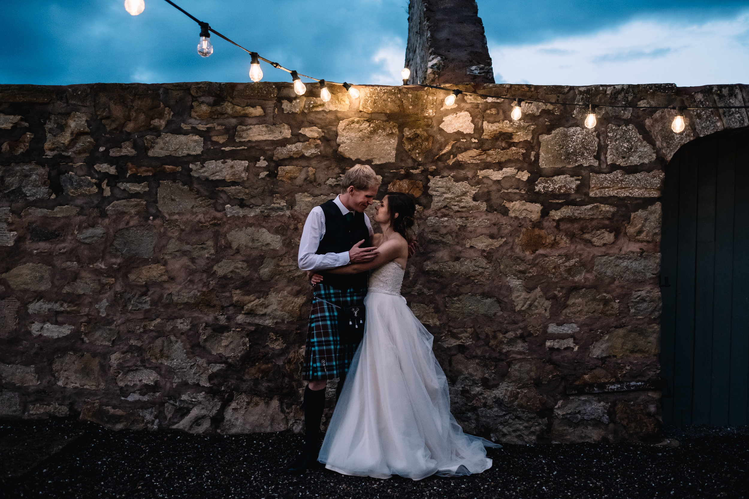 Bride + groom embrace