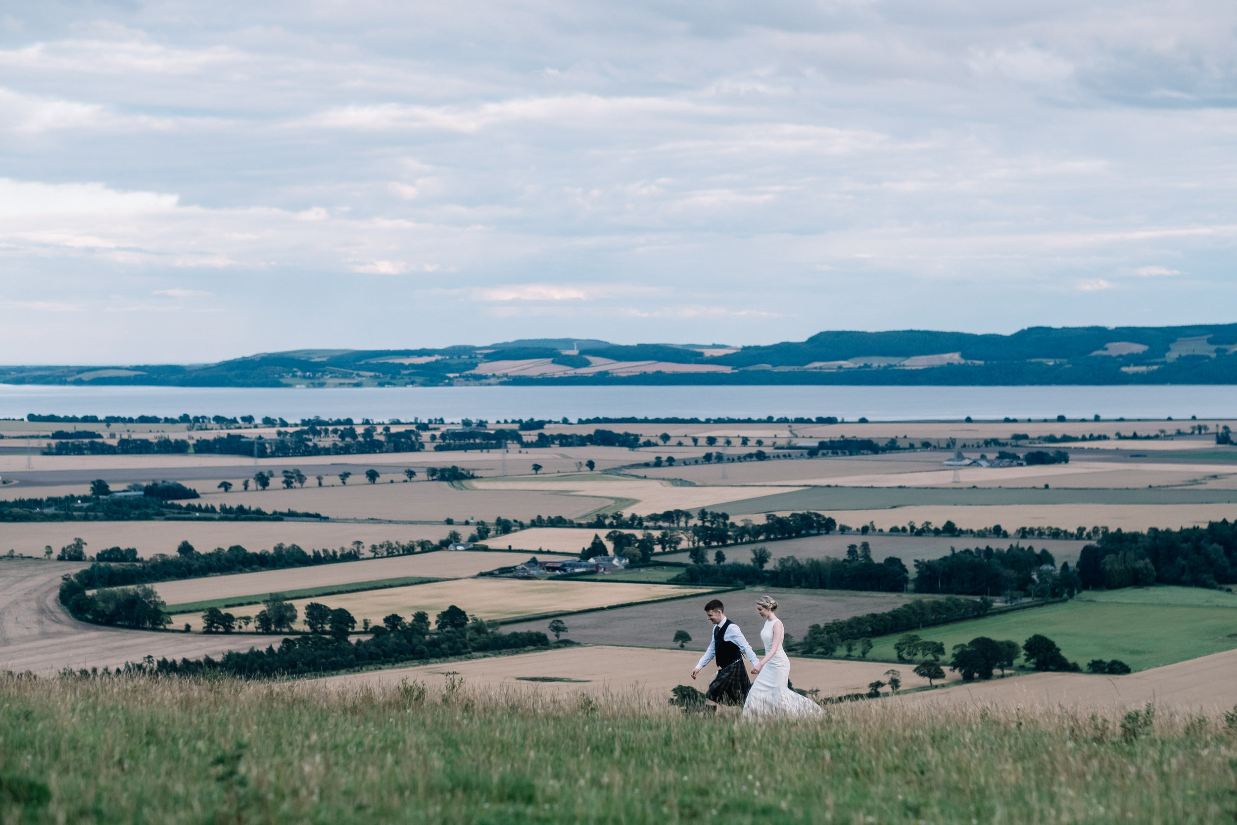 Bride and groom walking in Perthshire outdoors