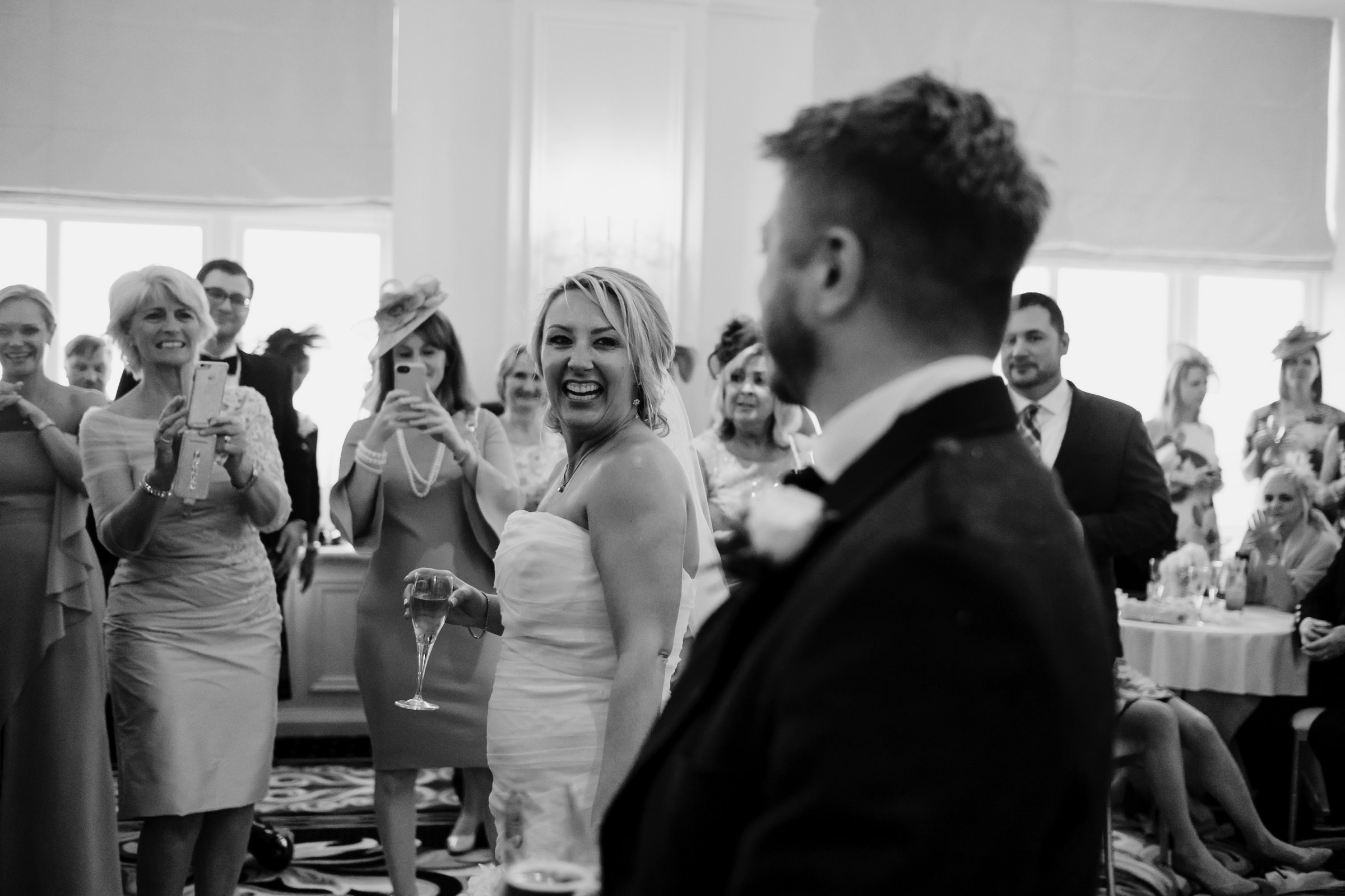 Bride and groom being received to their drinks reception