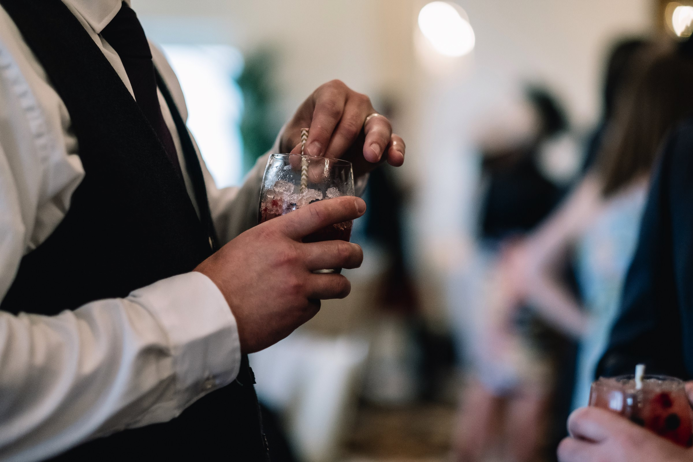 Guest holding drink