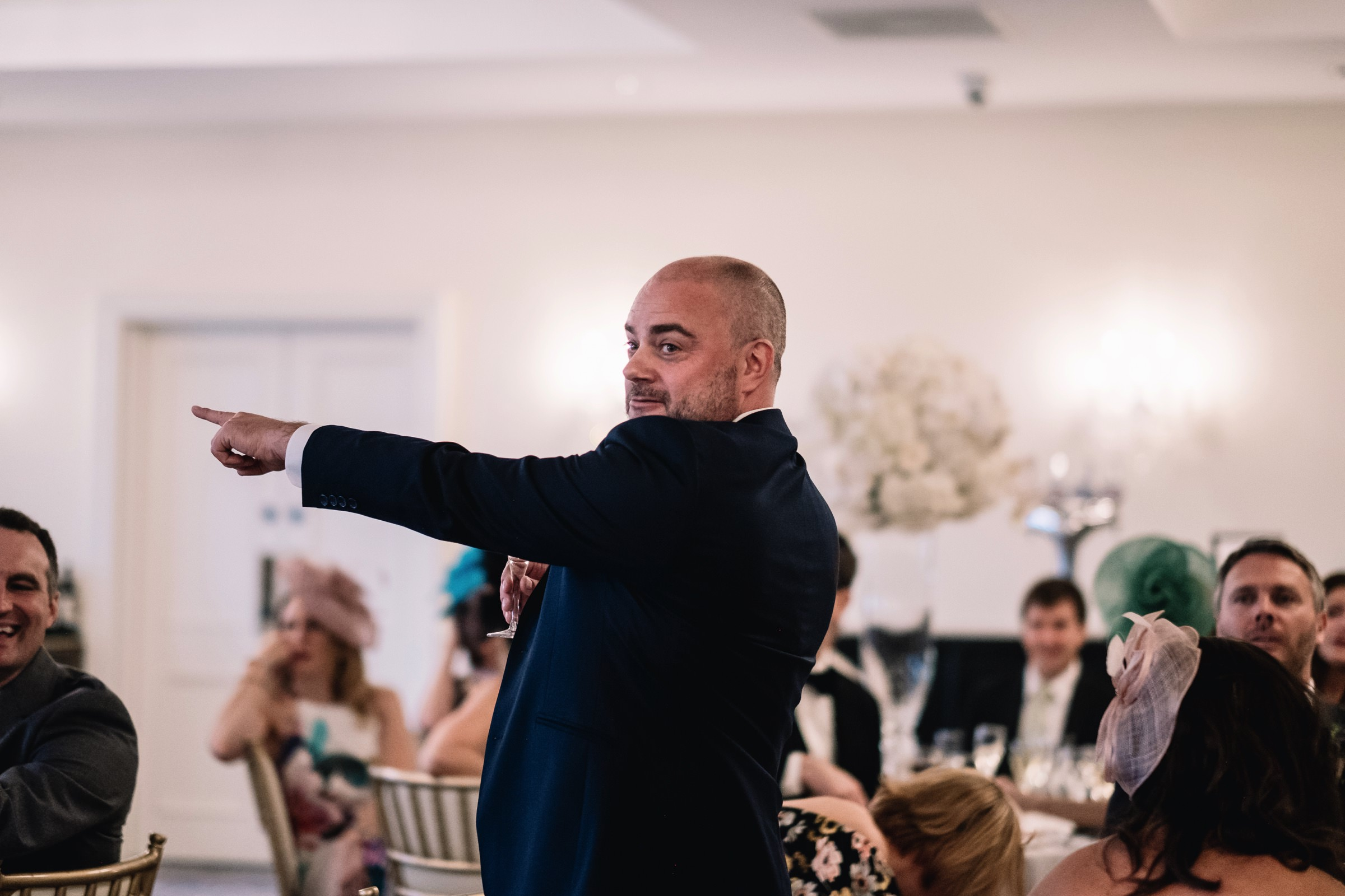Pointing wedding guest