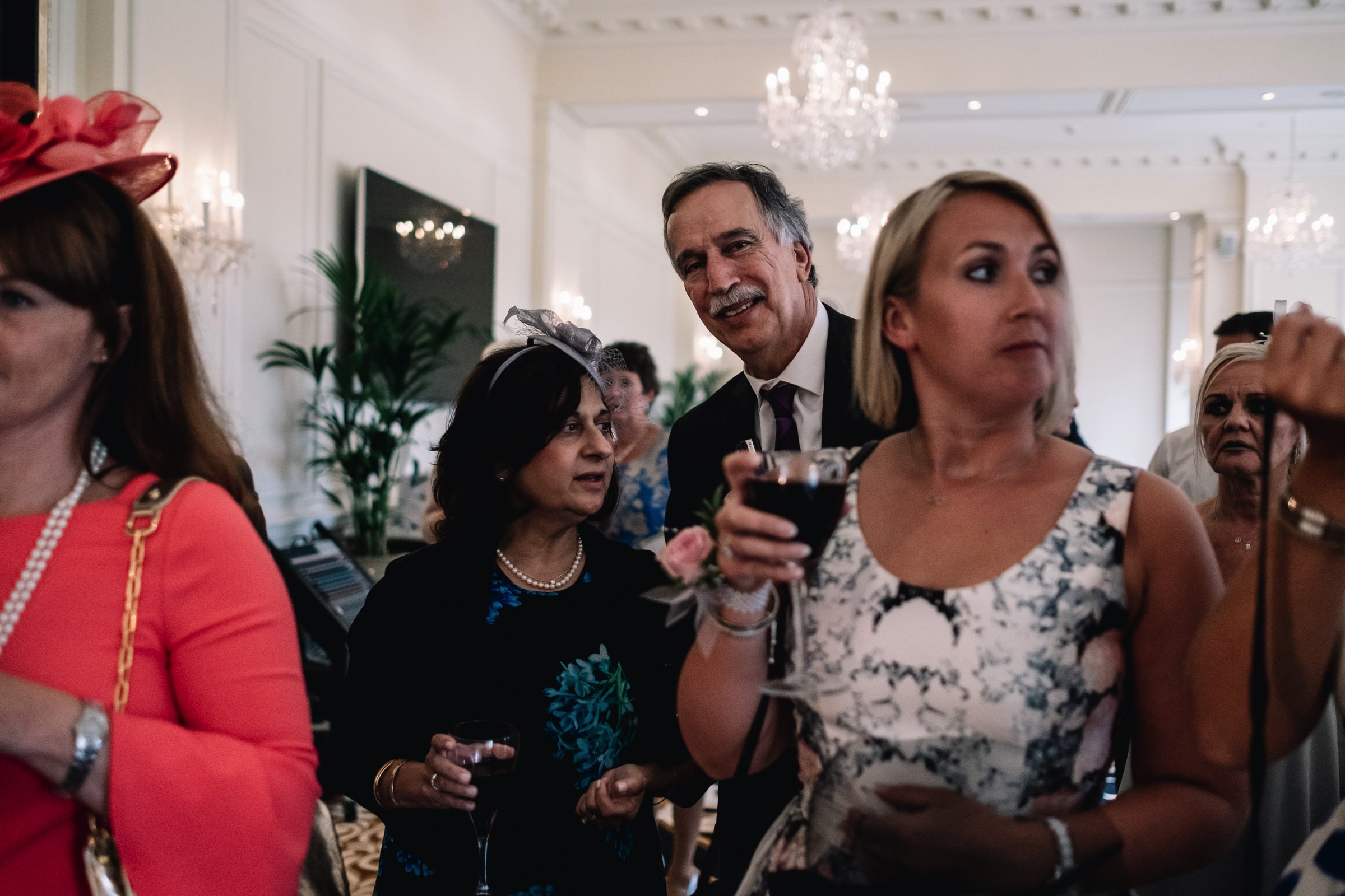Guests watch cake cutting