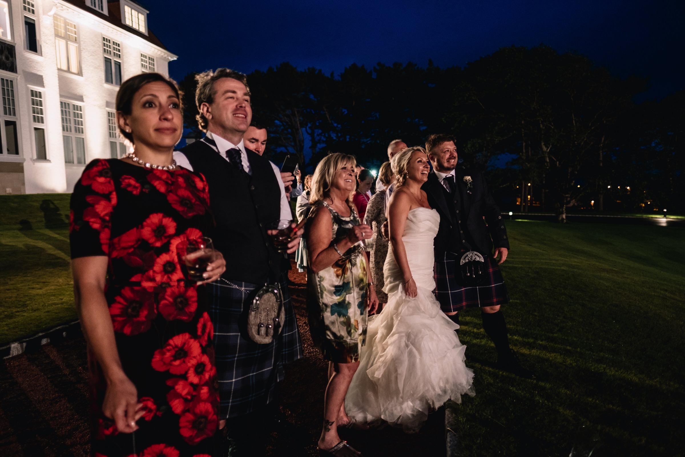 Wedding guests watch fireworks