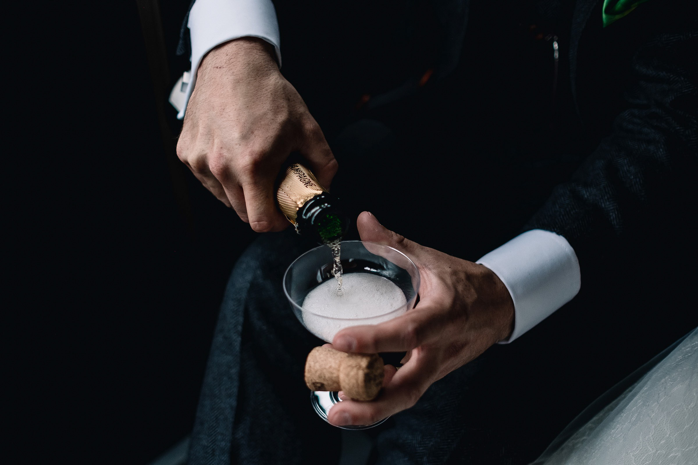 Groom pours Champagne