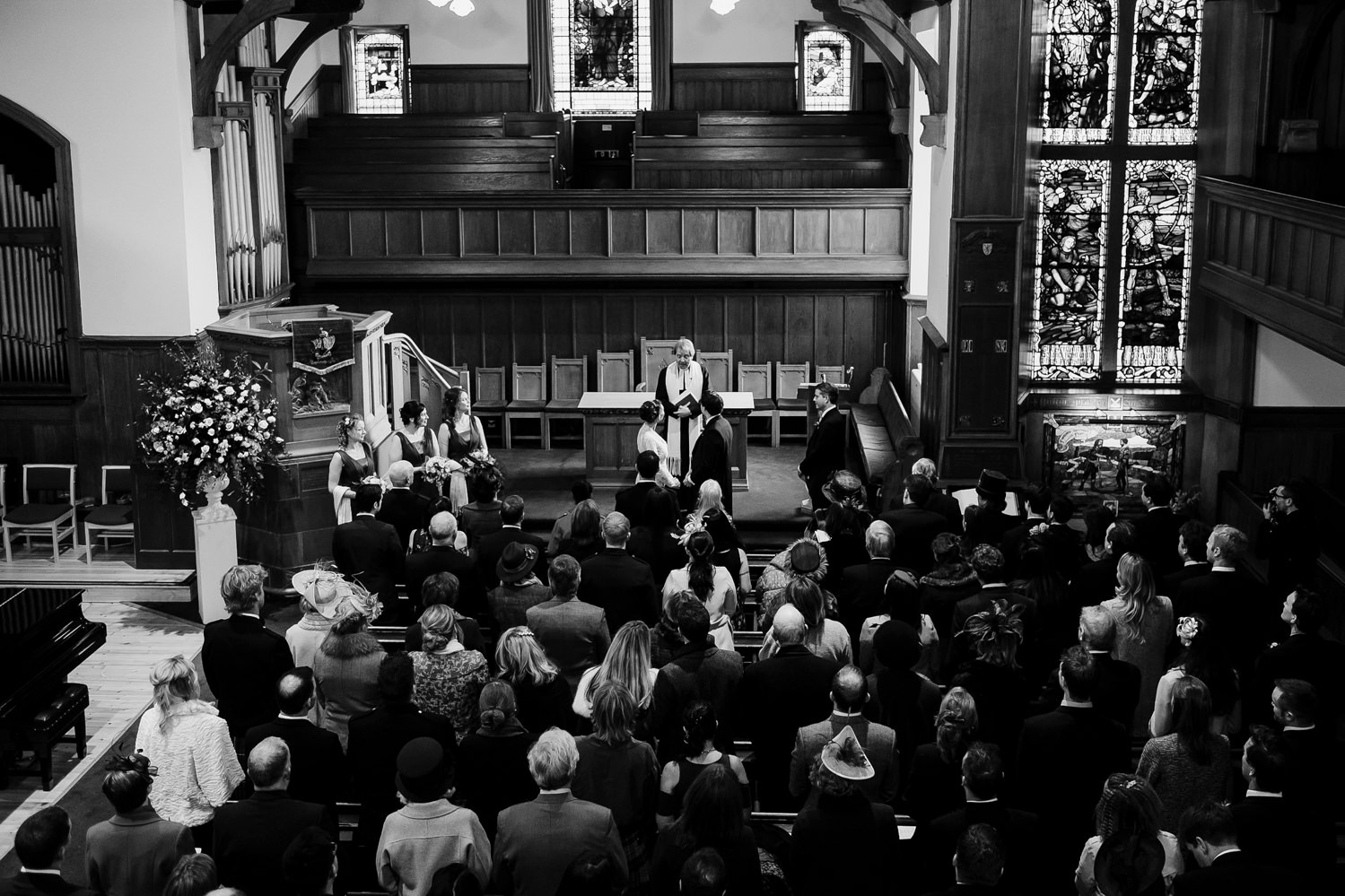 Aerial perspective of the congrgation and bridal party at Crammond Kirk