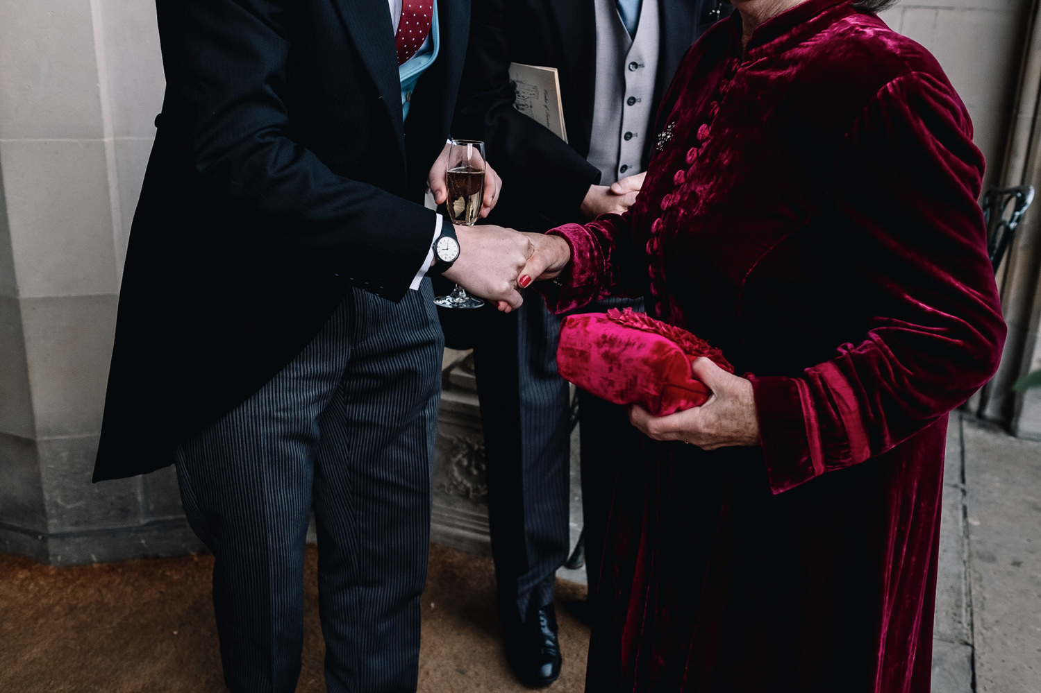grooms shakes his mother's hand upon arrival at Dundas Castle