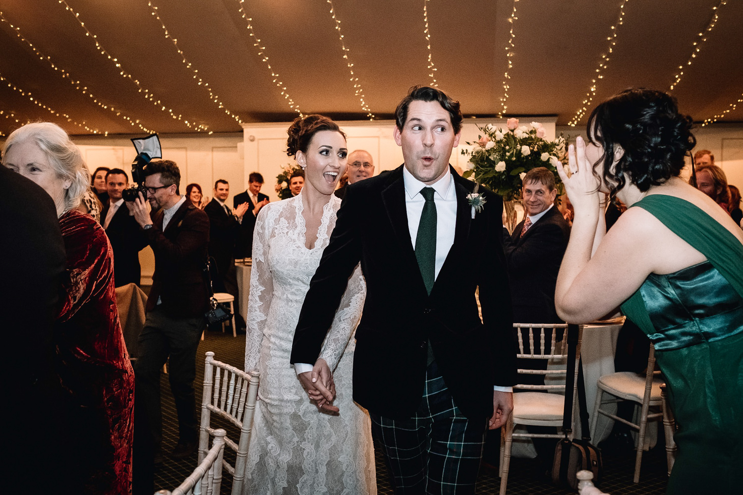groom laughing as he and bride are received into their wedding reception at Dundas Castle