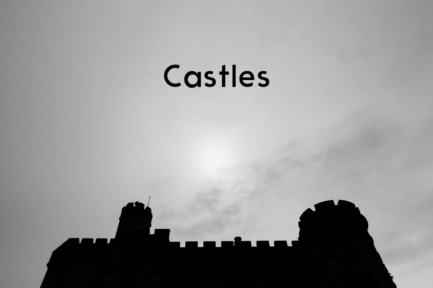A black and white silhoutted photo of Lochnell Castle.