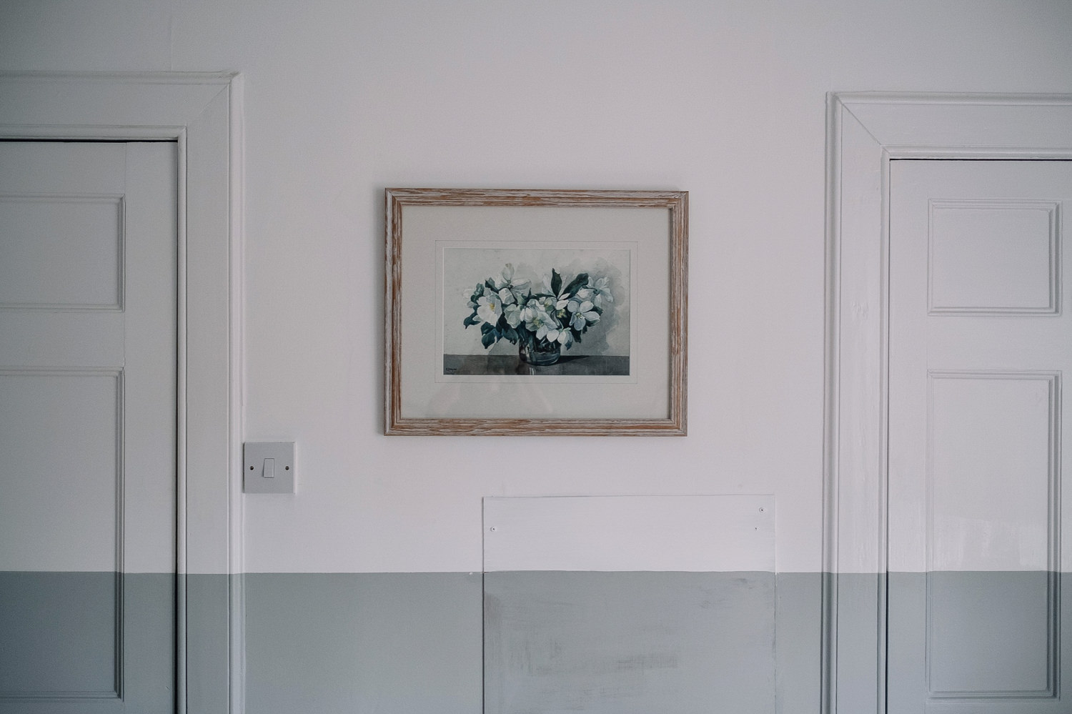 Picture hangs on the wall of one of the bedrooms in the Guardswell cottage