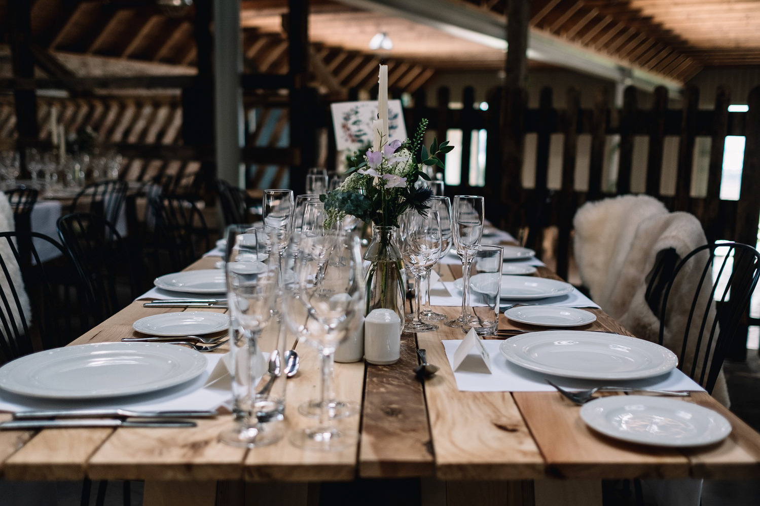 One long table in the barn has been set up for hte wedidng breakfast