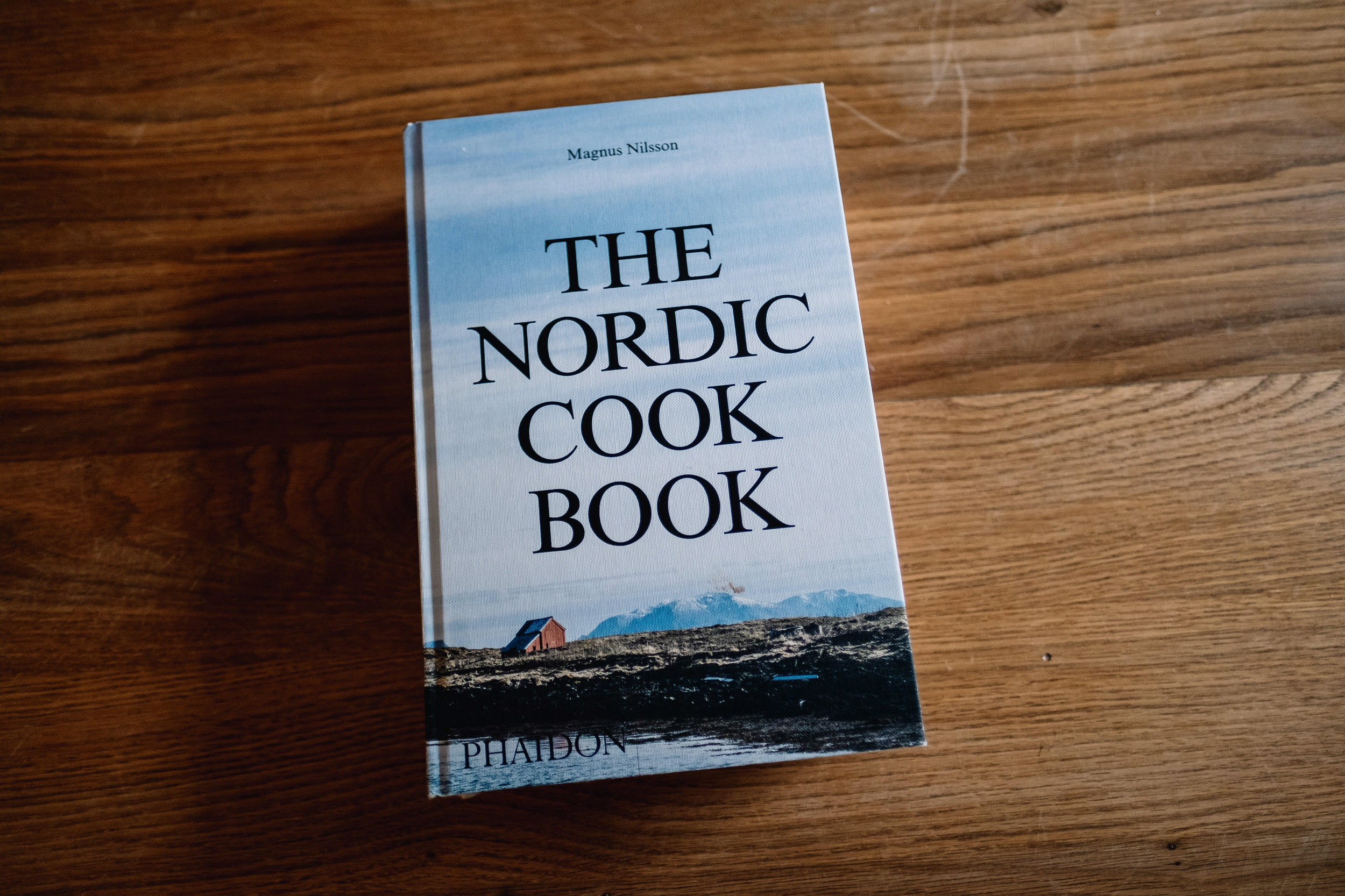 The Nordic Cook Book on the floor of the kitchen