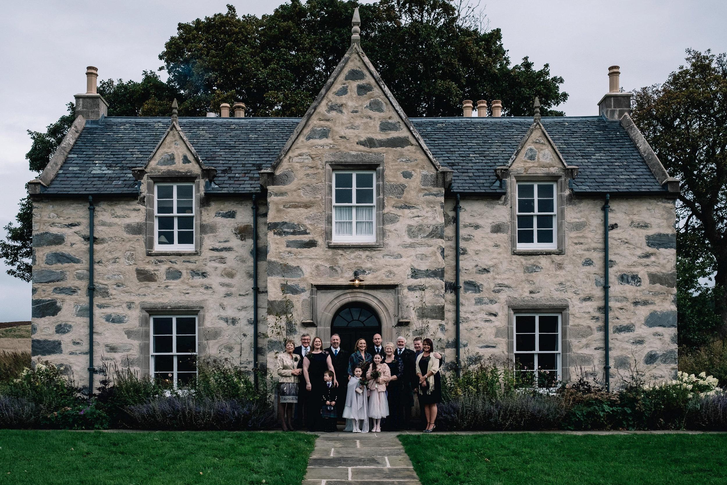 Full wedding party group shot outside of Killiehuntly Farmhouse