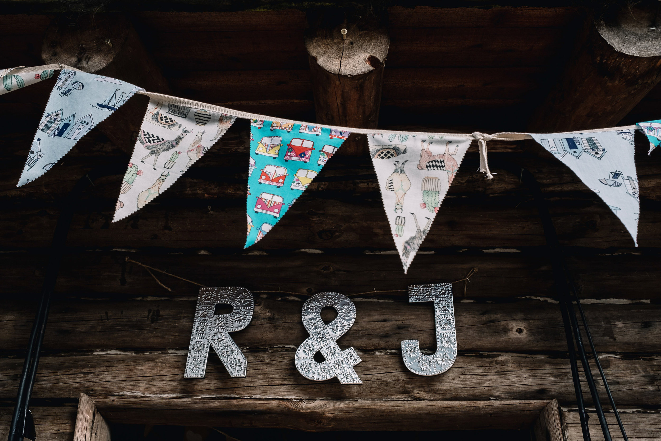 Bunting decorate the outside of the log cabin