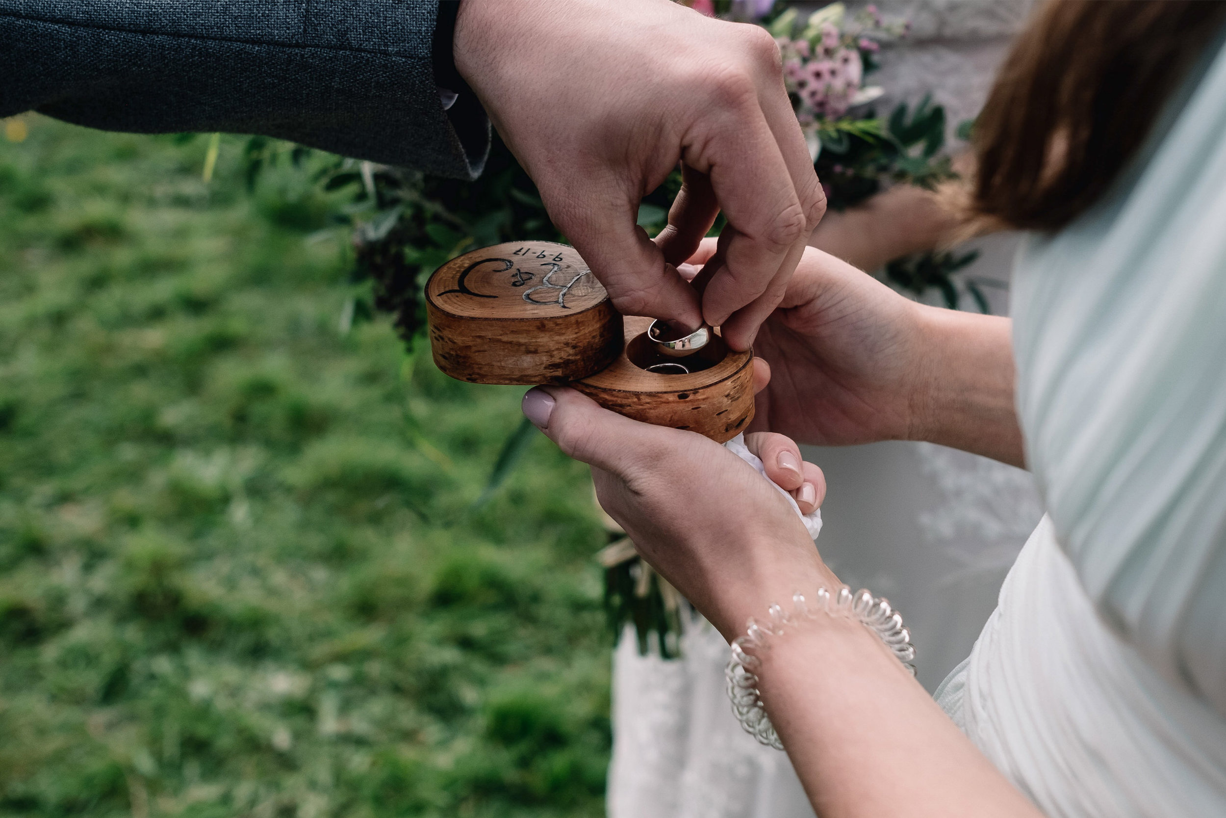 Groom takes rings from ring bearer