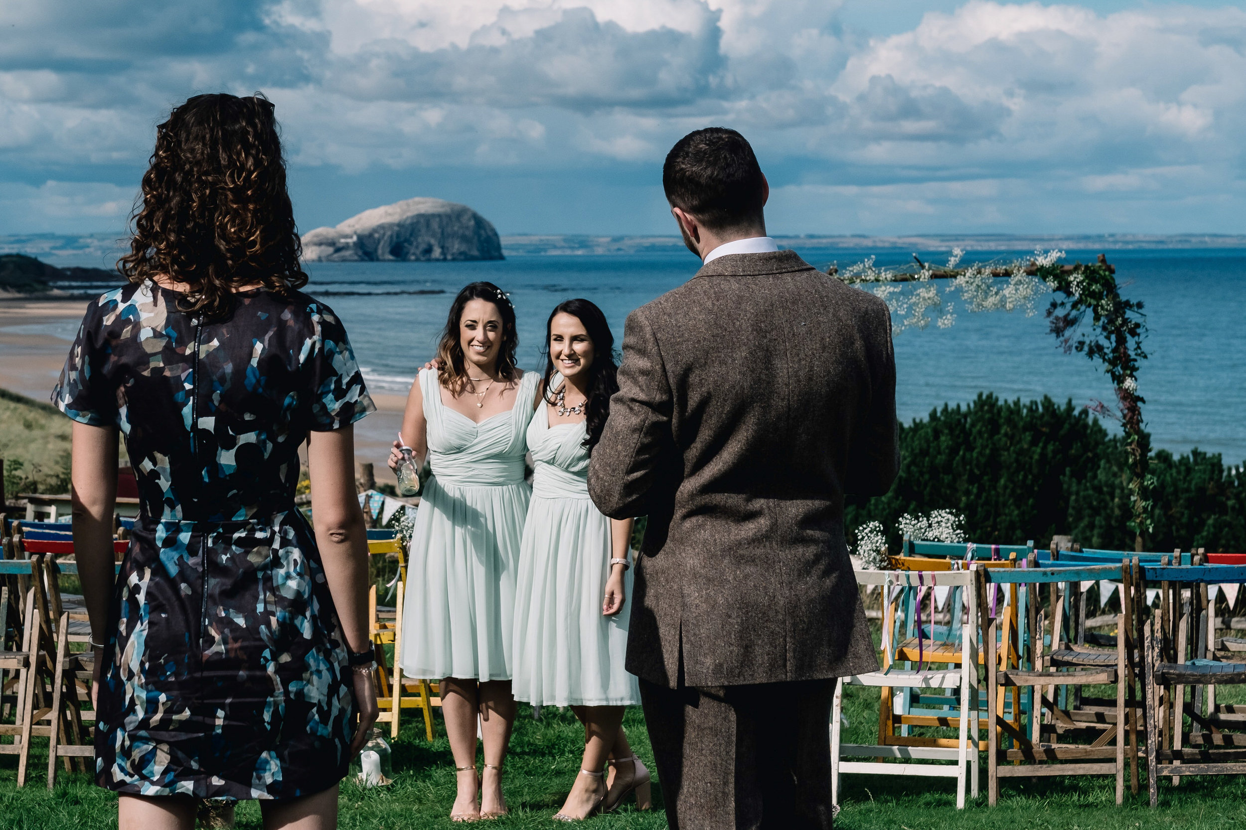 Bridesmaids pose for a photograph