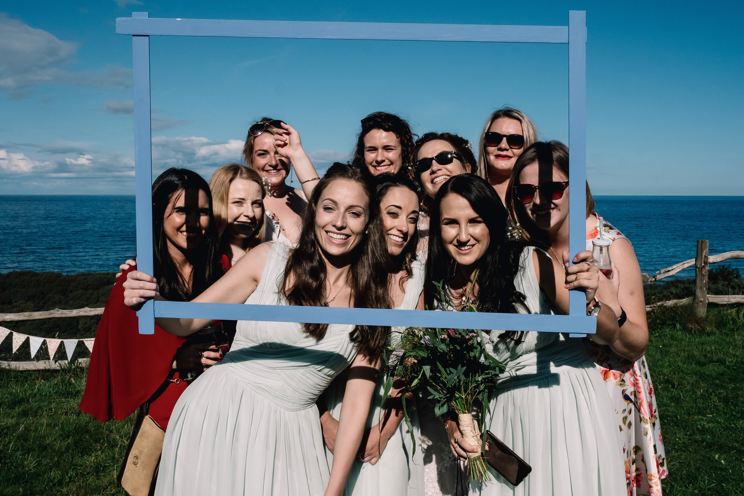Bride poses with her friends for a fun photo