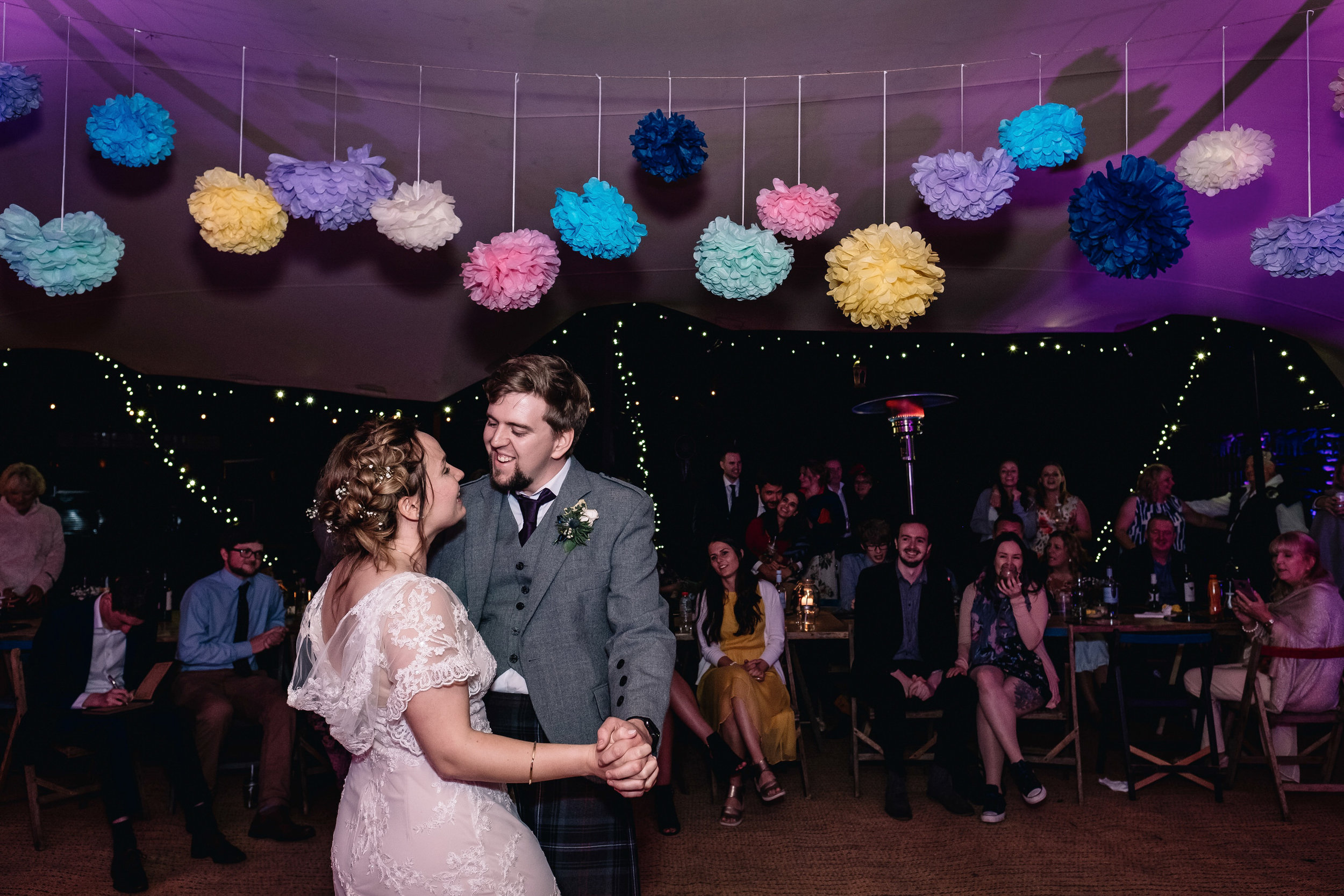 Bride and groom enjoy their first dance.