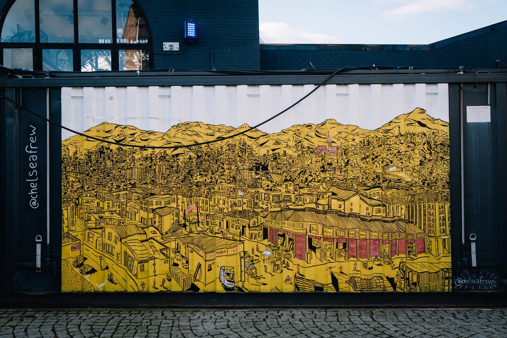 Yellow grafitti scene of Glasgow street.
