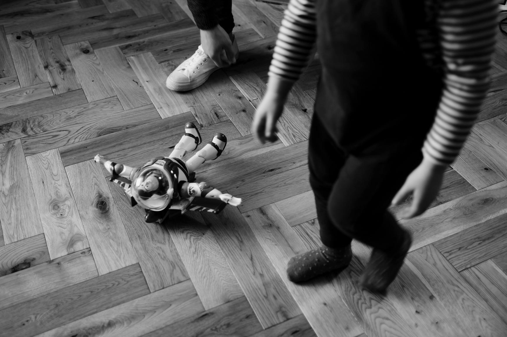 Child walks past toy on the floor.