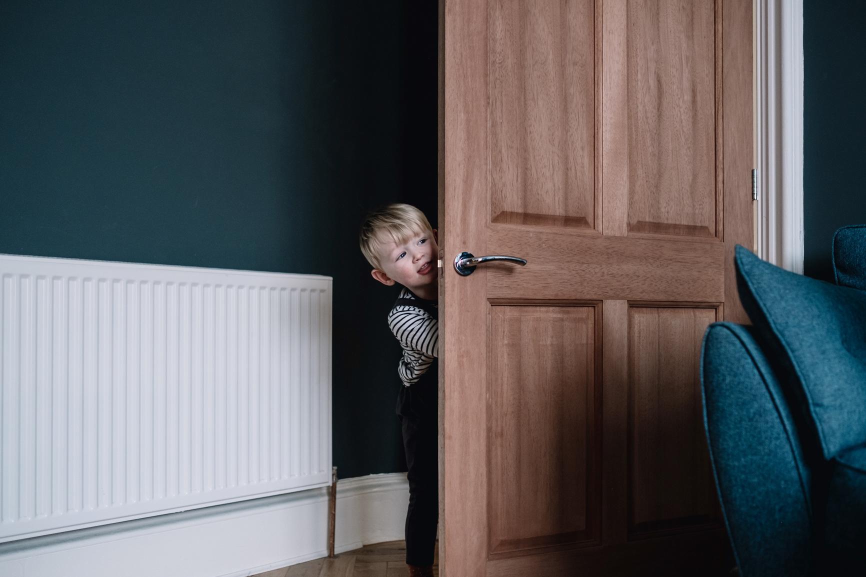 Child sticks head around the door.